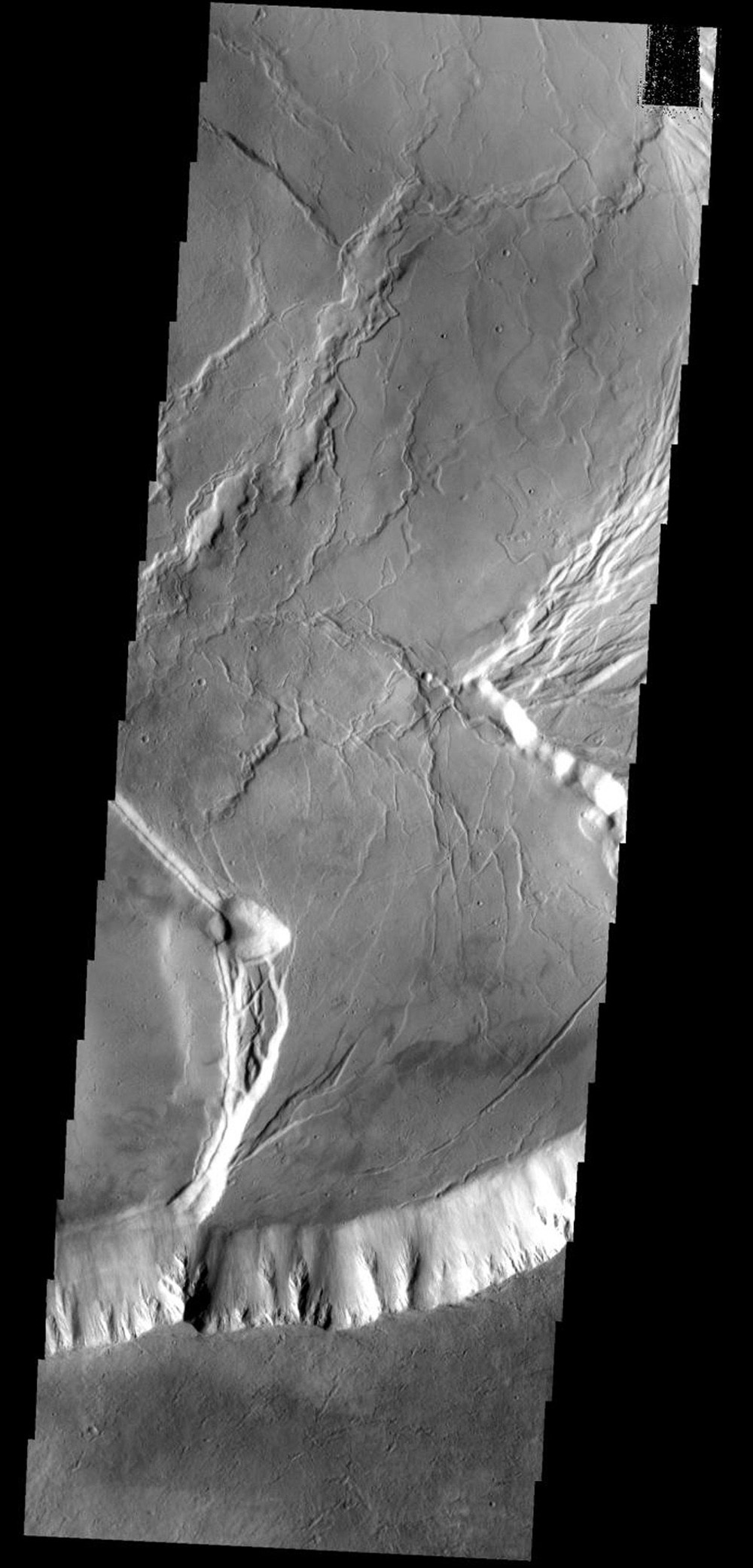 This image shows a portion of the summit caldera of Olympus Mons on Mars as seen by NASA's Mars Odyssey spacecraft.