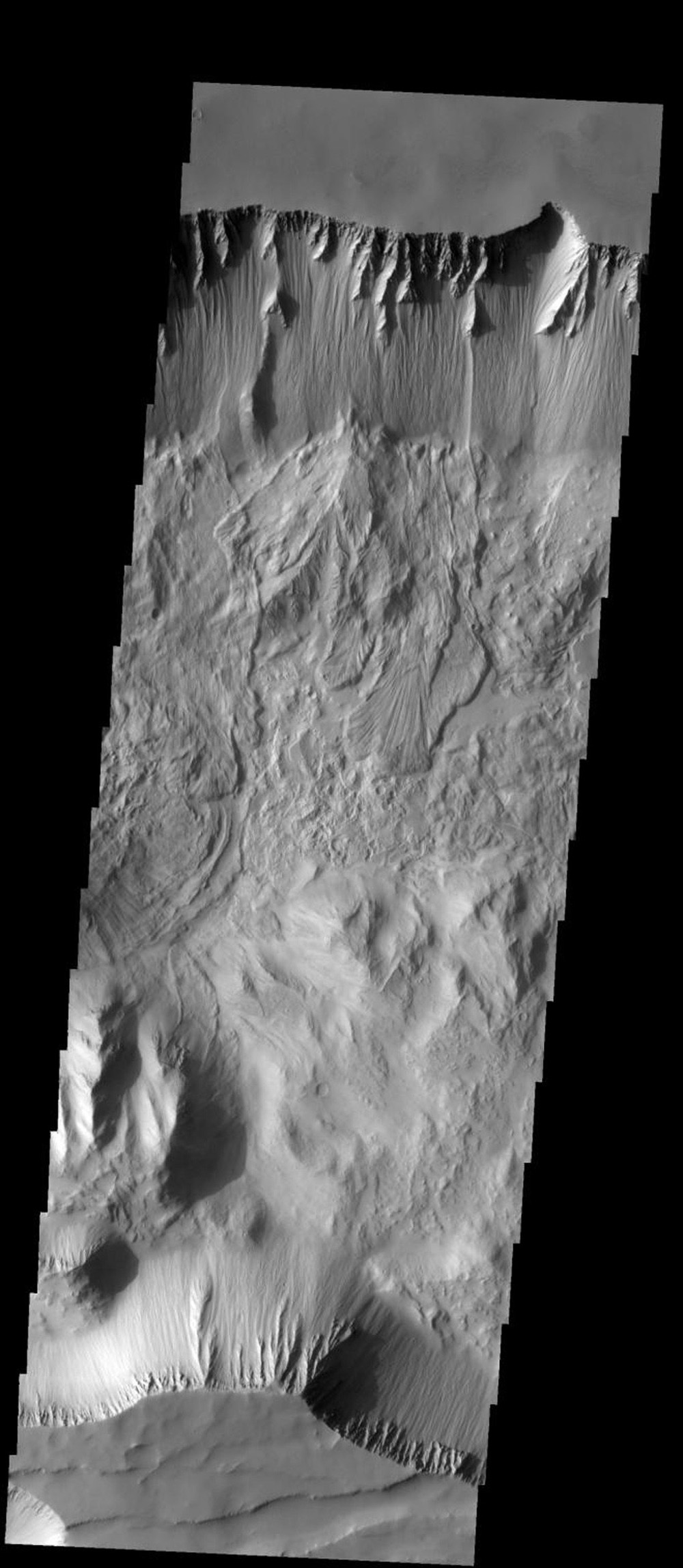 Several landslides are visible in this image of Thithomium Chasma on Mars as seen by NASA's Mars Odyssey spacecraft.
