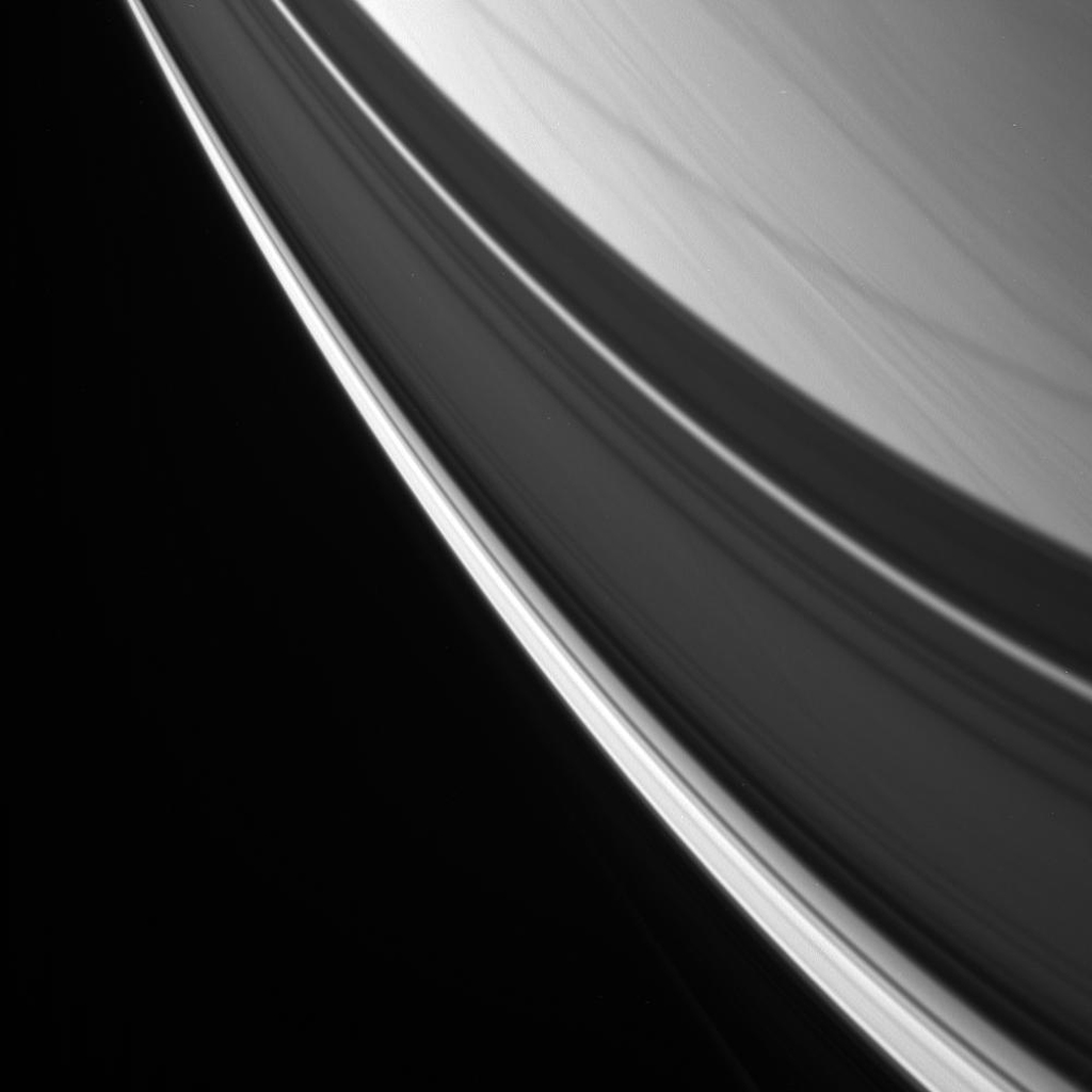 Streaks of cloud are overlain with graceful ring shadows in this view of Saturn's northern latitudes as seen by NASA's Cassini spacecraft.