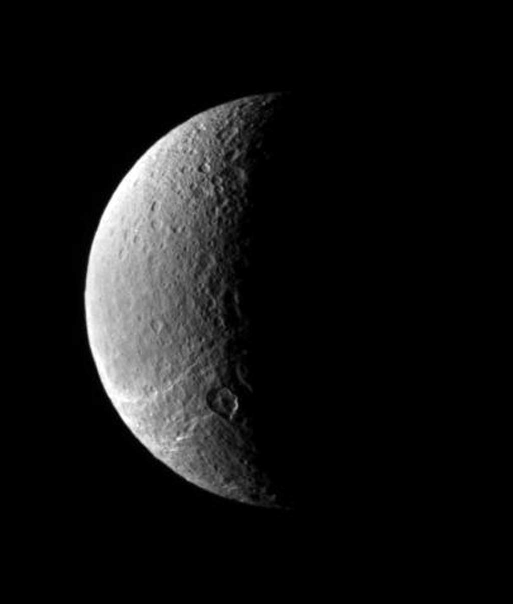 This view looks toward Rhea's north polar region, where icy fractures slither away toward the south as seen by NASA's Cassini spacecraft.