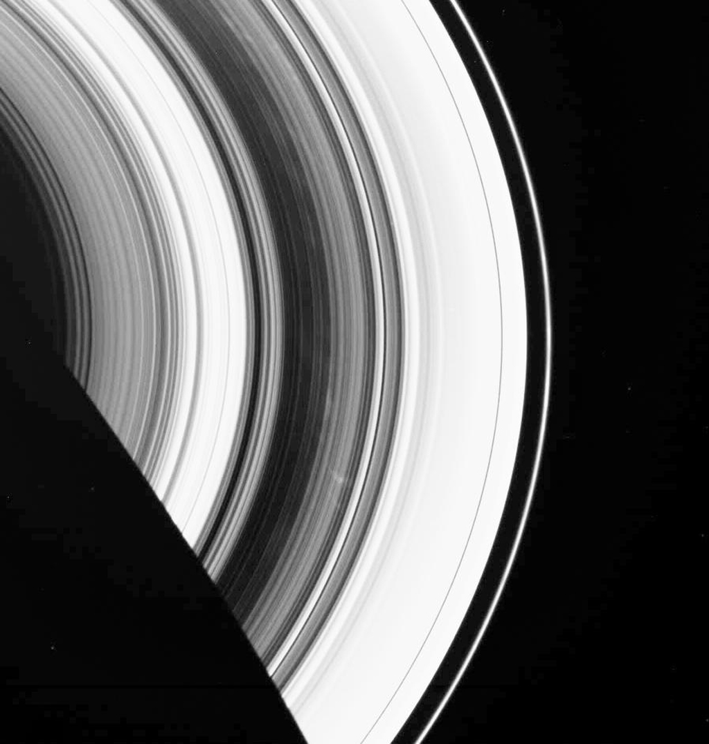 The dark B ring of Saturn is highlighted here by numerous faint spokes. The two most prominent spokes are seen below and to the right of center as seen by NASA's Cassini spacecraft.