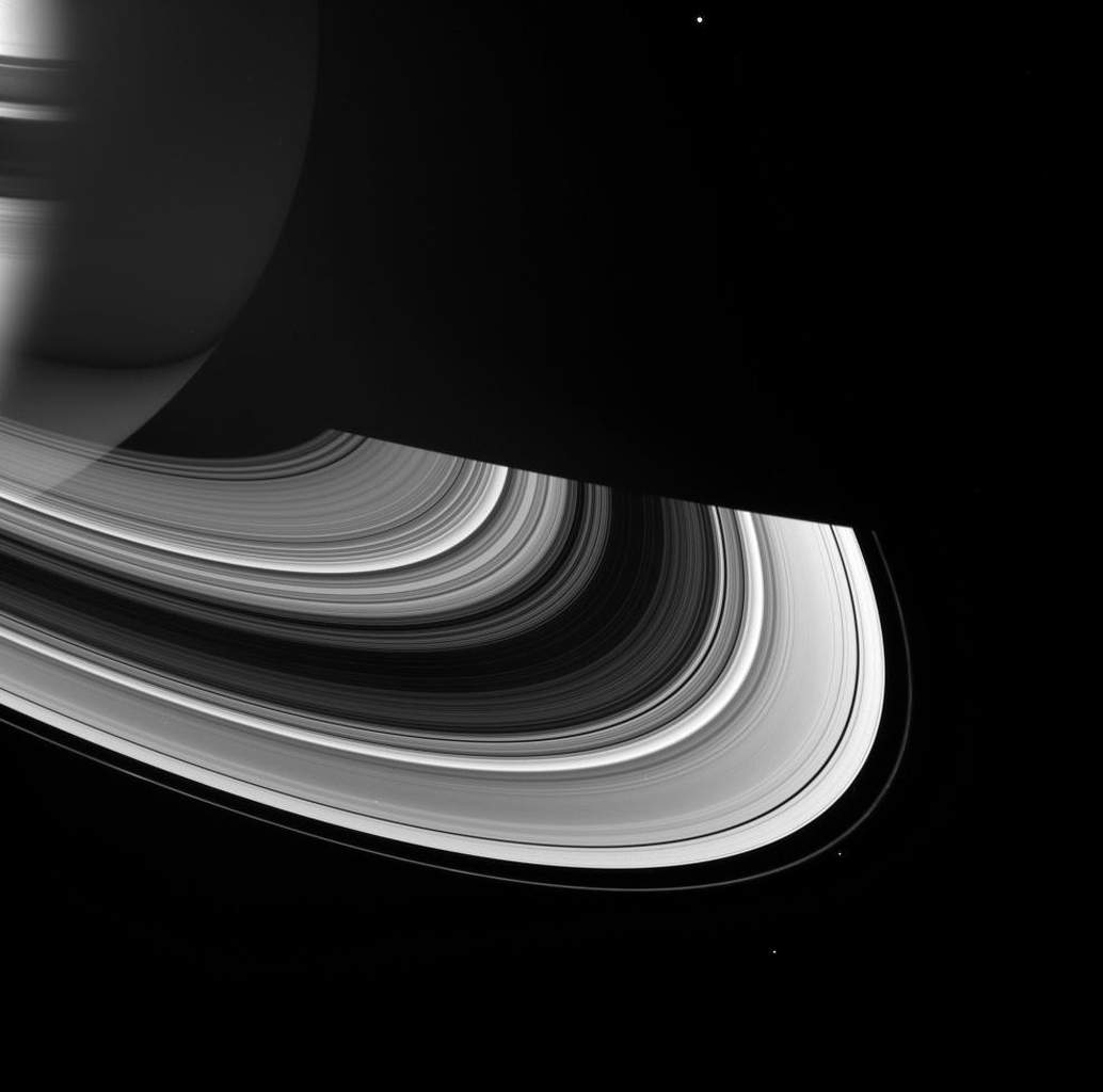 Saturn and its rings manifest a rich interplay between shadow and light in this image from NASA's Cassini spacecraft. The rings shine on their unilluminated side by virtue of scattered sunlight emerging from its passage through the ringplane.