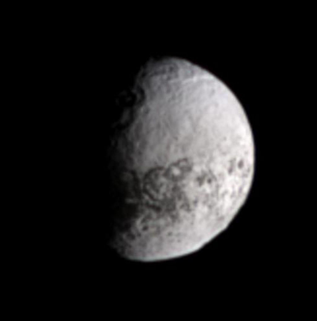 NASA's Cassini spacecraft views terrain on the bright, trailing side of Iapetus in natural color.