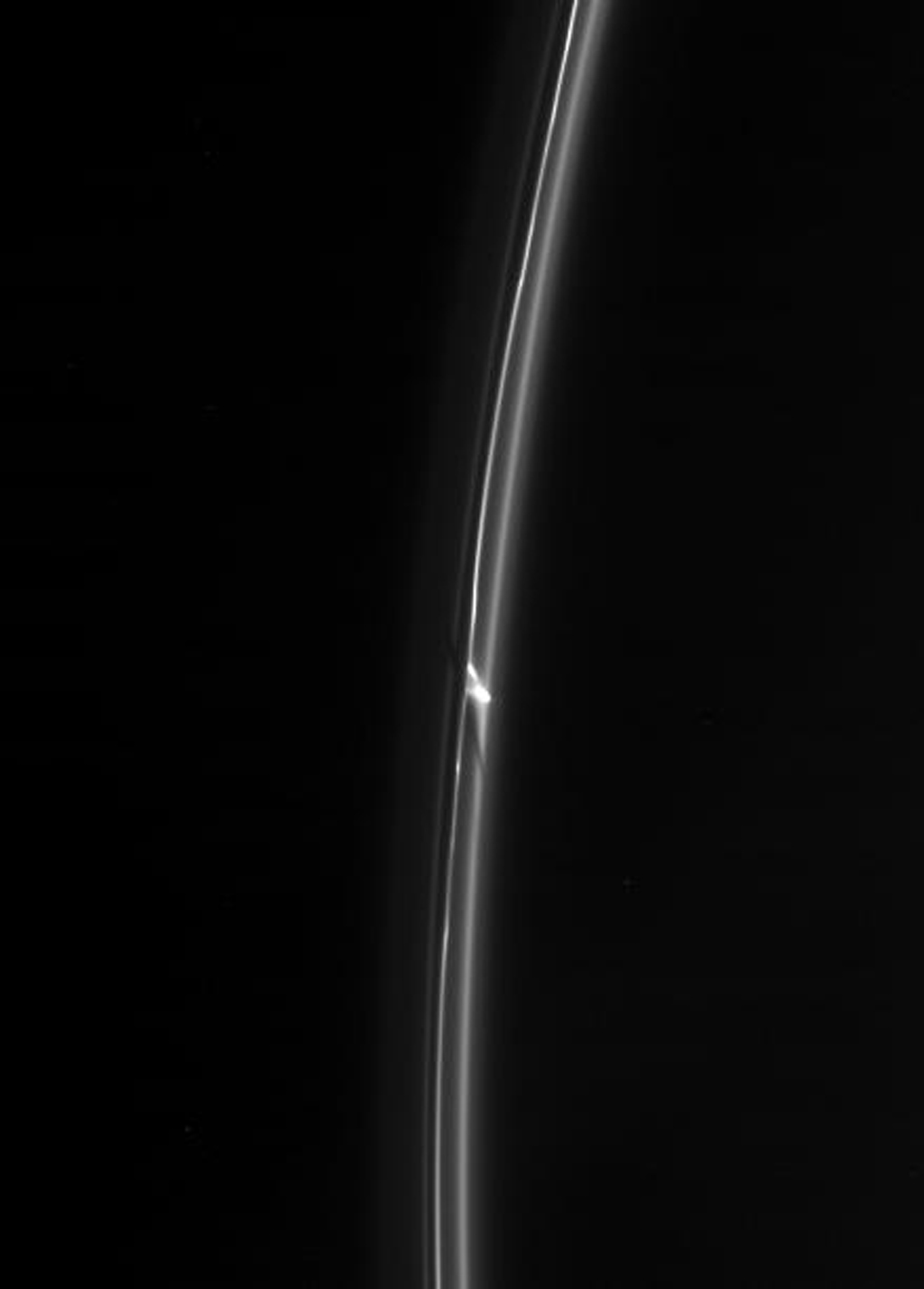 NASA's Cassini spacecraft spies an intriguing bright clump in Saturn's F ring. Also of interest is the dark gash that appears to cut through the ring immediately below the clump.