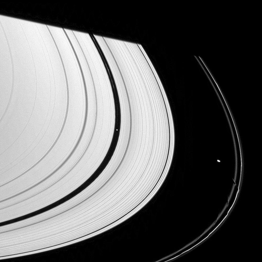 The effects of three of Saturn's ring moons can be spotted in this single narrow-angle camera view captured by NASA's Cassini spacecraft.