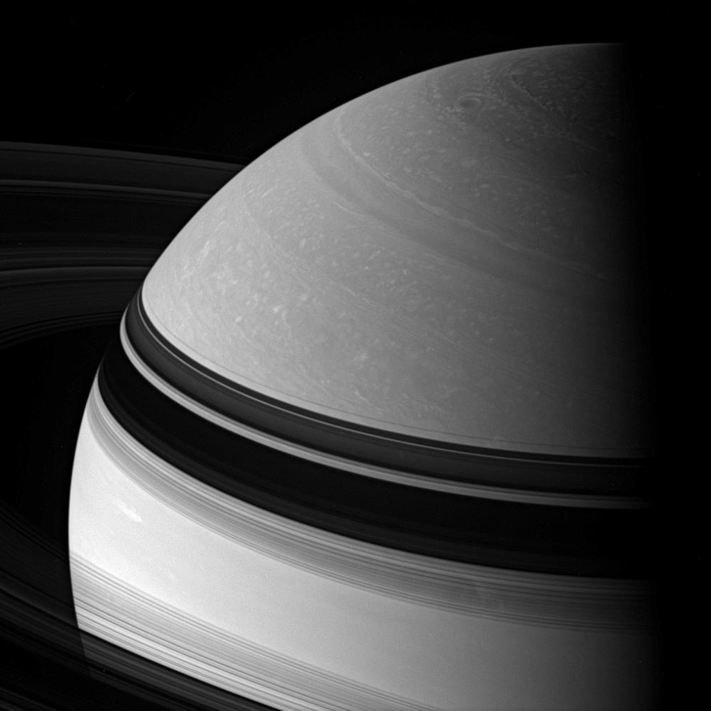 Incredible swirling details in Saturn's northern clouds can be seen in this dazzling view from NASA's Cassini spacecraft. Shadows cast by the rings embrace the northern hemisphere.