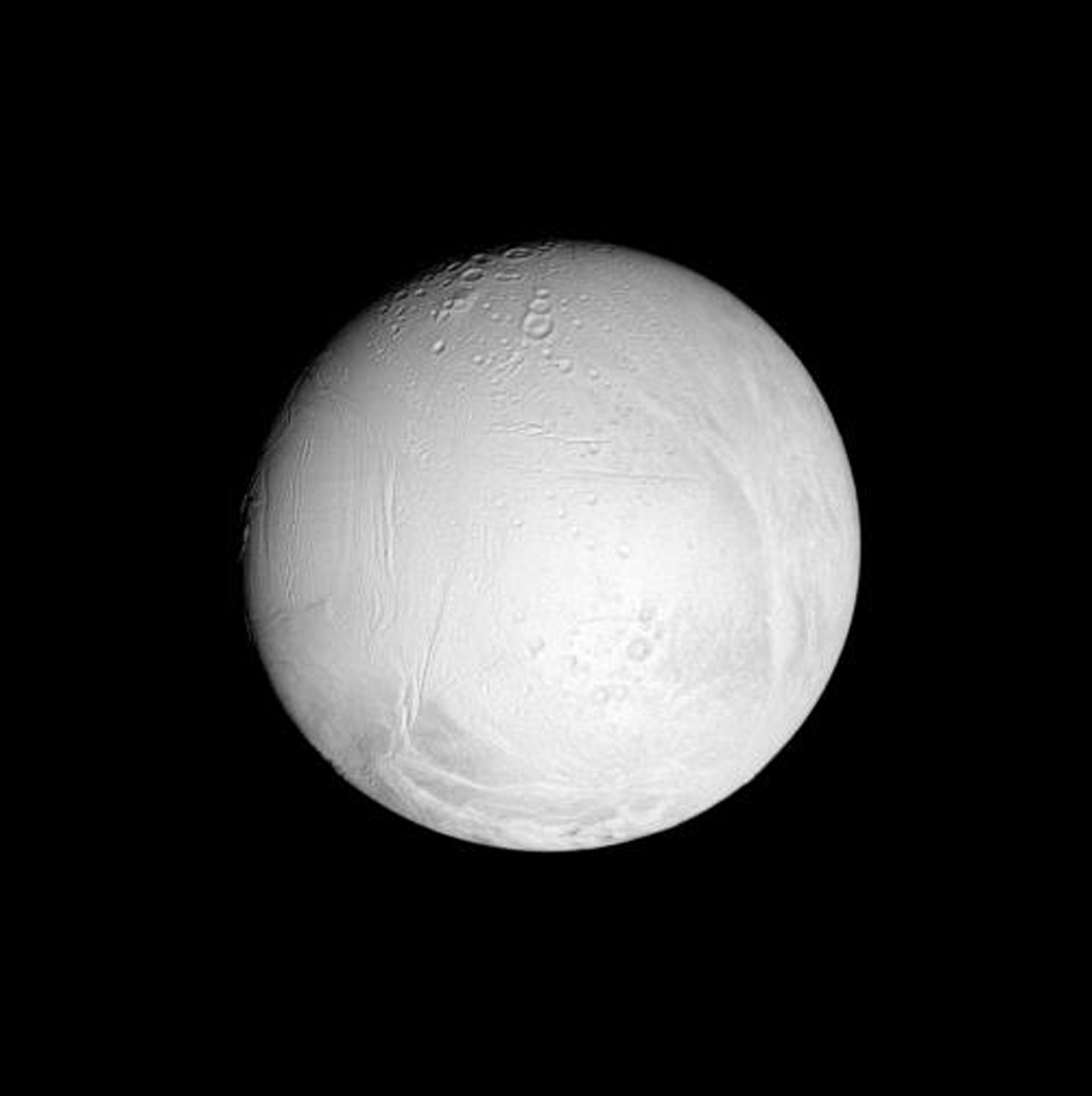 This nearly equatorial view shows cratered regions on Enceladus in the central part of its leading hemisphere and high northern latitudes. This image was taken in polarized green light with NASA's Cassini spacecraft's narrow-angle camera.