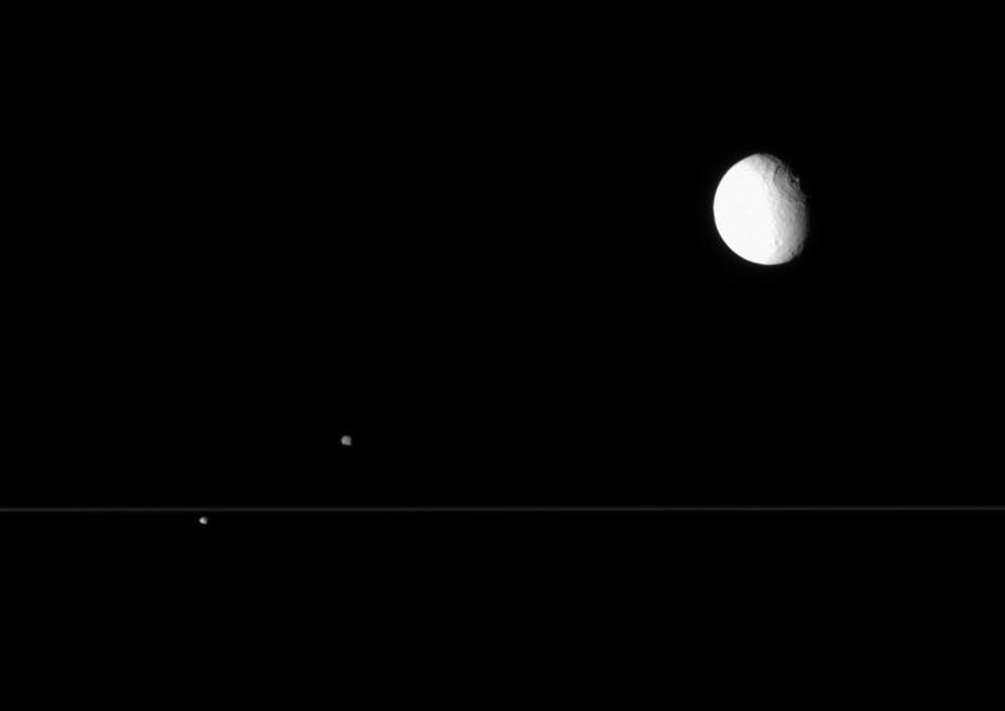 NASA's Cassini spacecraft views from edge-on with the rings are perfect for capturing multiple Saturnian moons grouped closely.