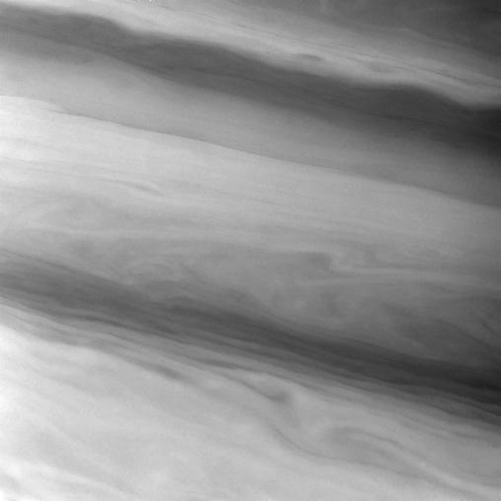 NASA's Cassini spacecraft spies smooth, sometimes wavy, contours in the banded east-west flowing clouds of Saturn. This view shows clouds in Saturn's northern mid-latitudes.