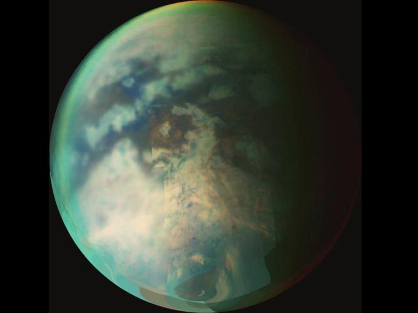 This image from NASA's Cassini spacecraft is a composite of several images taken during two separate Titan flybys on Oct. 9 (T19) and Oct. 25 (T20). The large circular feature near the center may be the remnant of a very old impact basin.