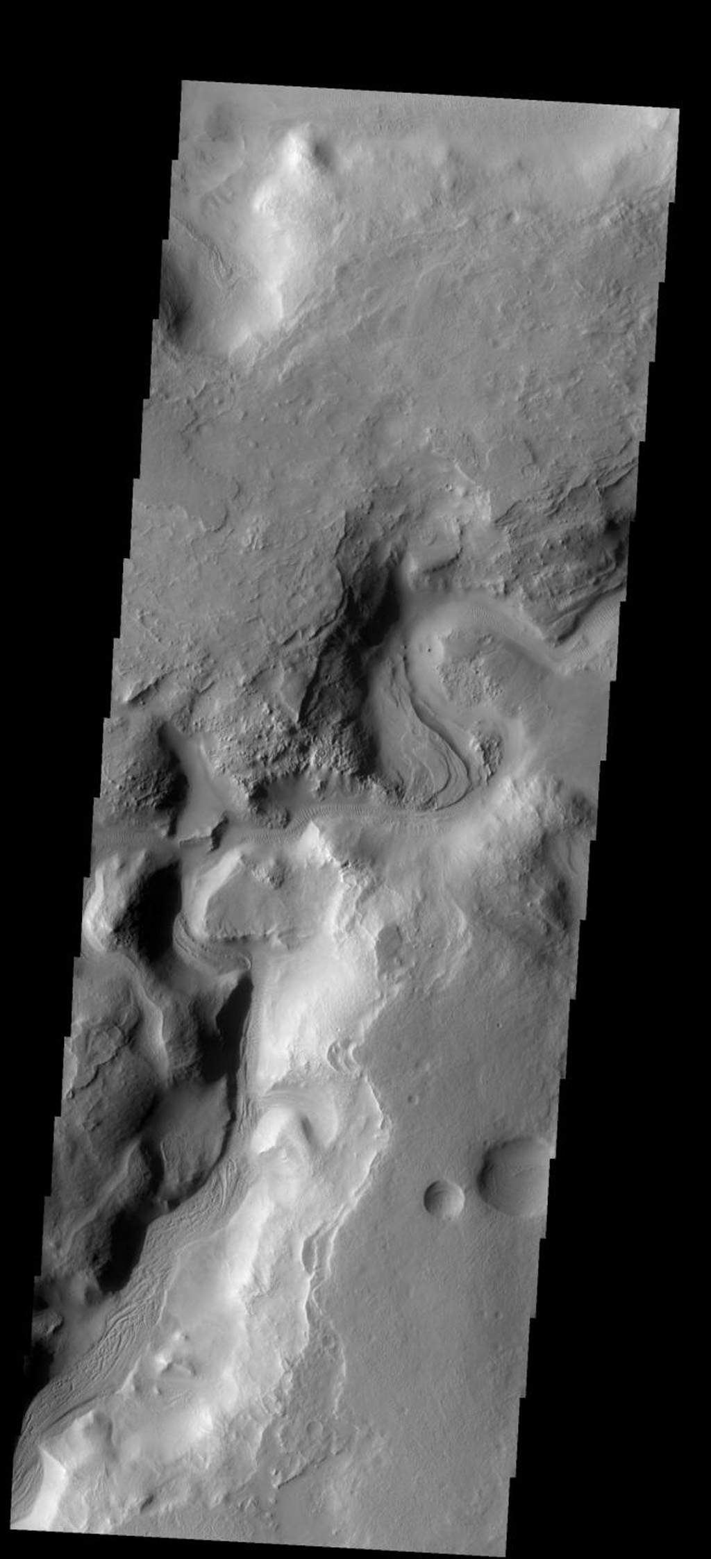 A portion of Auqakuh Vallis on Mars is shown in this image from NASA's 2001 Mars Odyssey spacecraft.