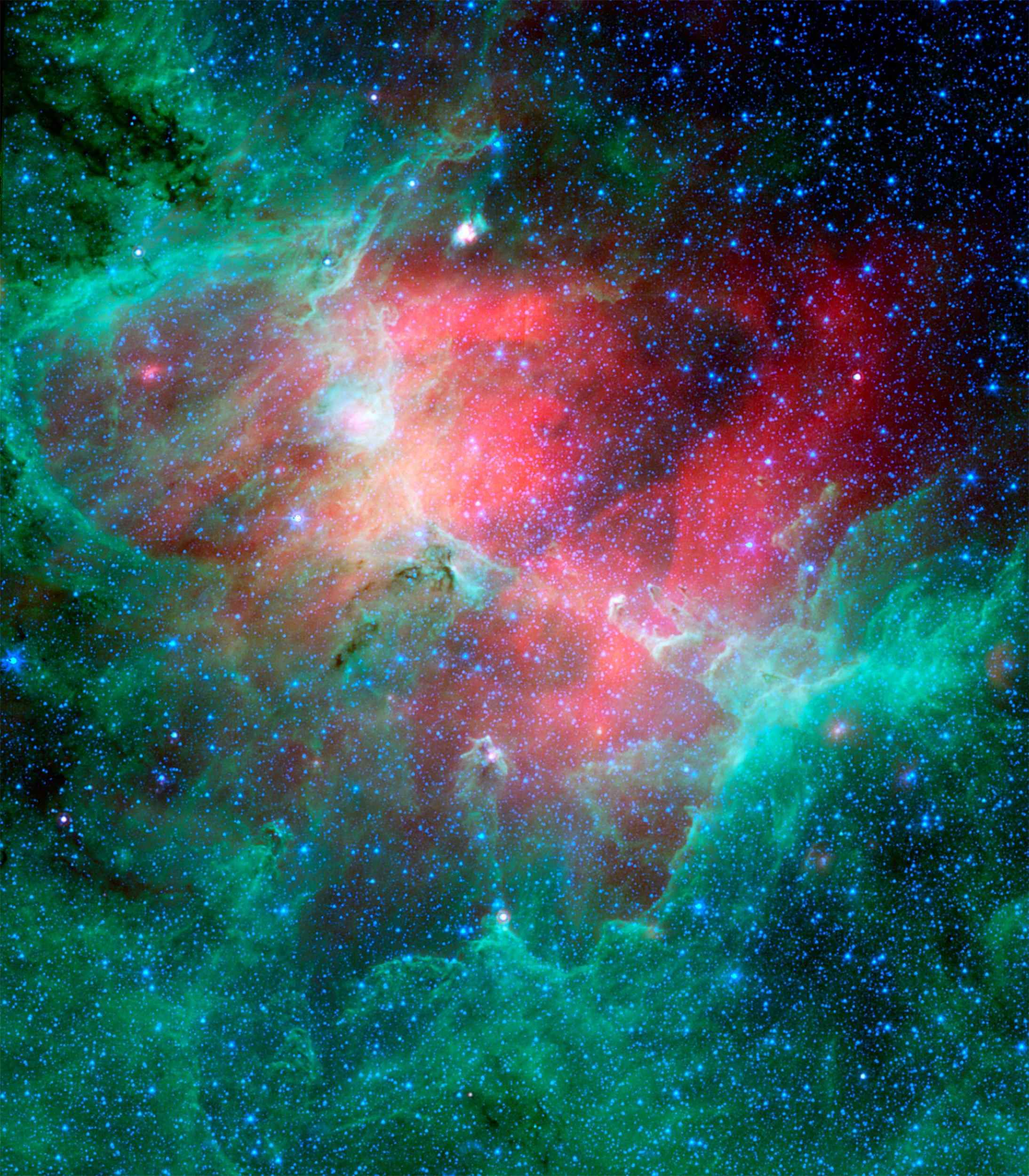 This majestic view taken by NASA's Spitzer Space Telescope tells an untold story of life and death in the Eagle nebula, an industrious star-making factory located 7,000 light-years away in the Serpens constellation.