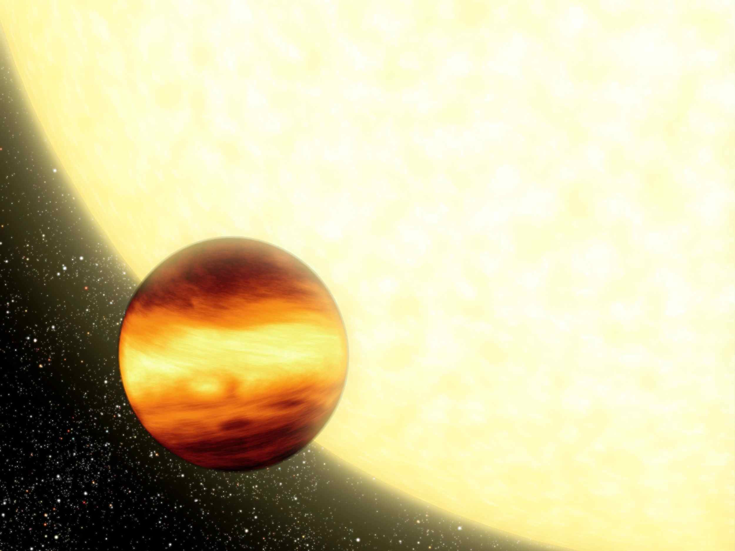 This artist's concept shows a gas-giant planet orbiting very close to its parent star, creating searingly hot conditions on the planet's surface