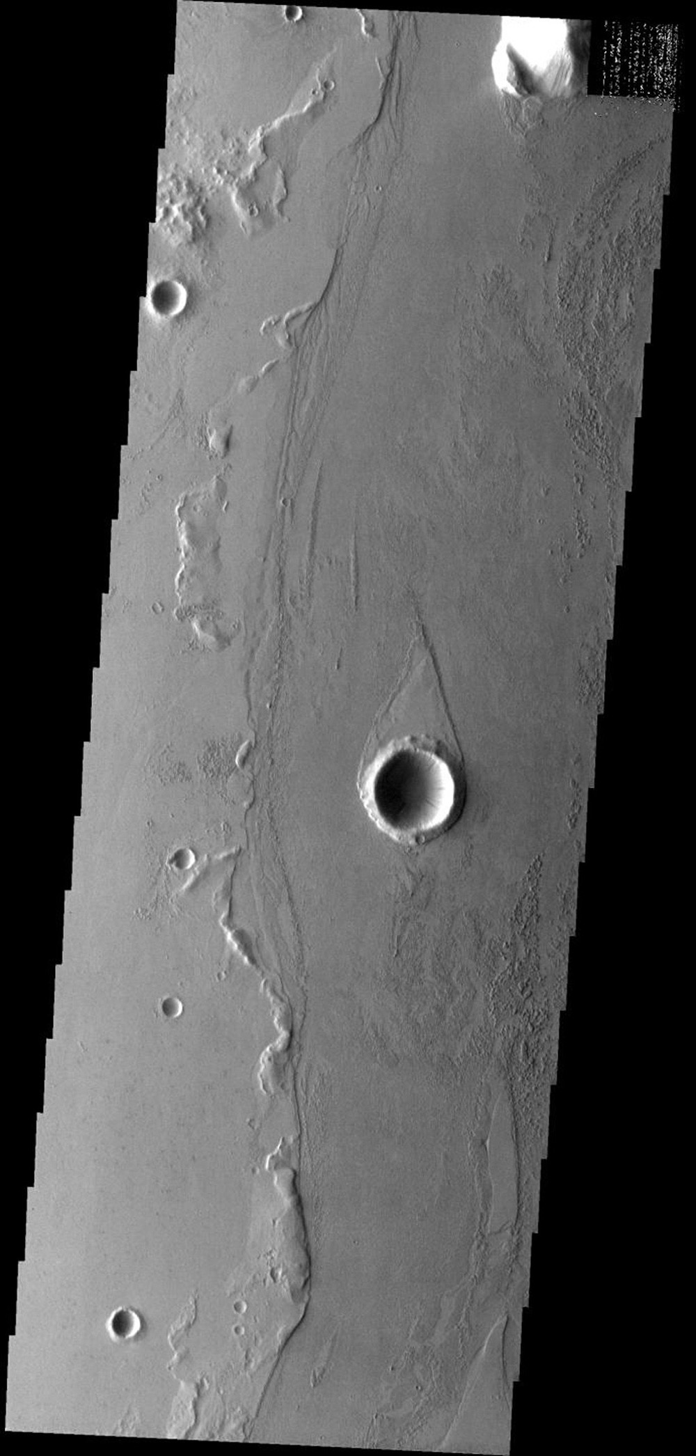 The teardrop-shaped 'island' in this image was formed by the flow of fluid lava rather than liquid water on Mars as seen by NASA's Mars Odyssey spacecraft.