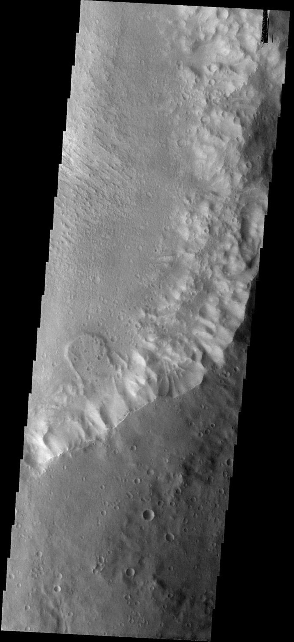 This small landslide on Mars is located in an unnamed crater as seen by NASA's Mars Odyssey spacecraft.