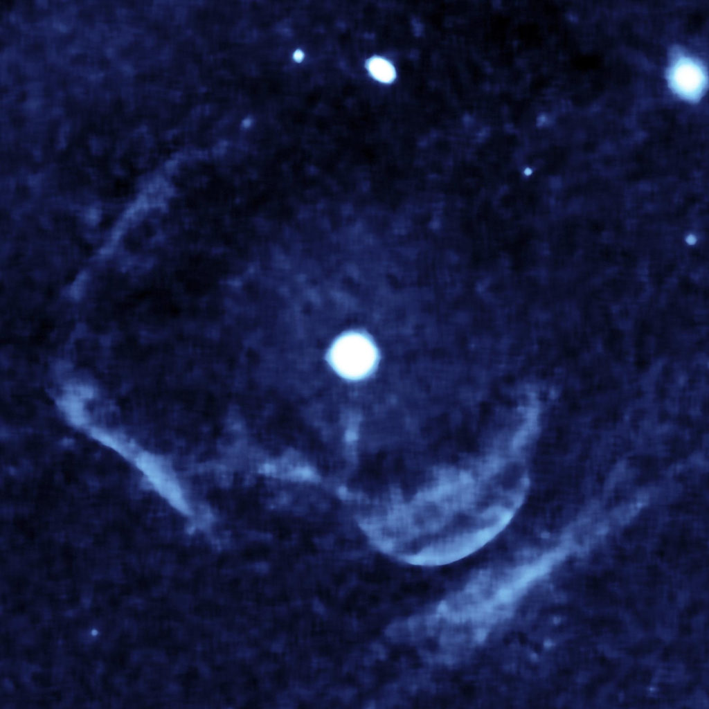 This enhanced image from the far-ultraviolet detector on NASA's Galaxy Evolution shows a ghostly shell of ionized gas around Z Camelopardalis, a binary, or double-star system featuring a collapsed, dead star known as a white dwarf, and a companion star.
