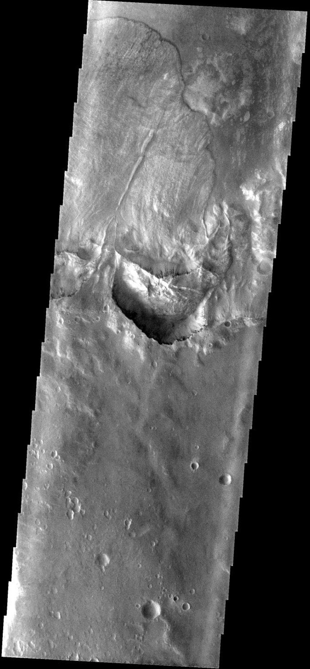 This image from NASA's Mars Odyssey spacecraft shows a large landslide on Mars, located within an unnamed crater to the WSW of Holden Crater.