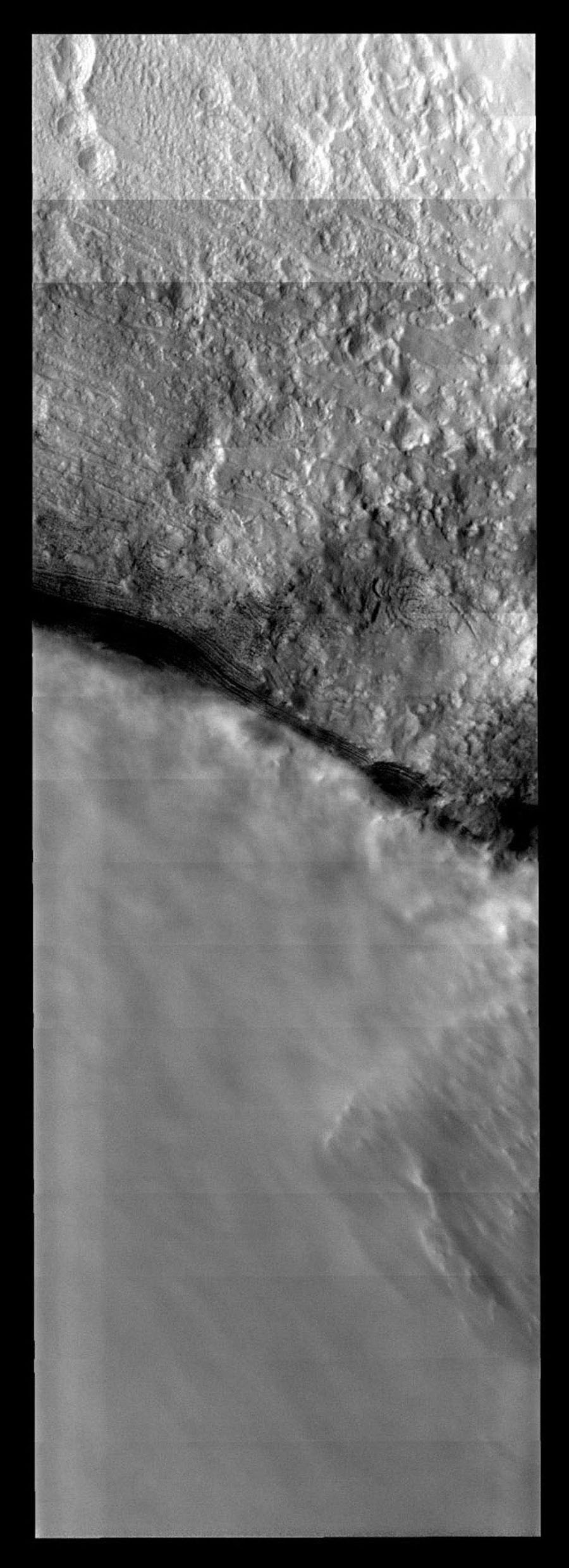 This image from NASA's Mars Odyssey spacecraft shows the border between clear and cloudy that is likely the edge of a polar trough on Mars, with the clouds located in the trough itself.