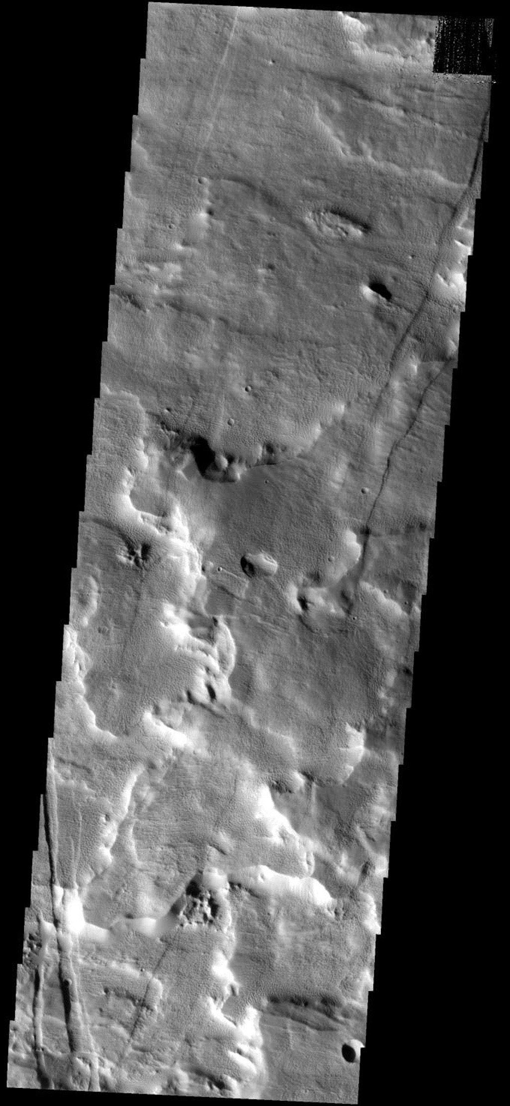 This image from NASA's Mars Odyssey spacecraft shows part of the flank of the Arsia Mons volcano on Mars. The surface of the flank comprised of small ridges and honeycomb-like depressions.