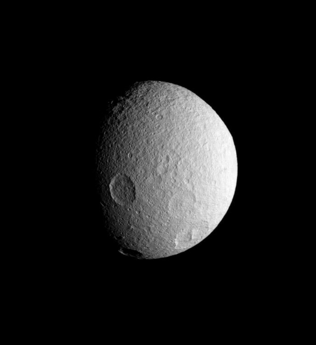 NASA's Cassini spacecraft spies four large impact basins on the southern hemisphere of icy Tethys. Tethys, like the other airless worlds of the Solar System, wears the record of countless impacts experienced over the eons.