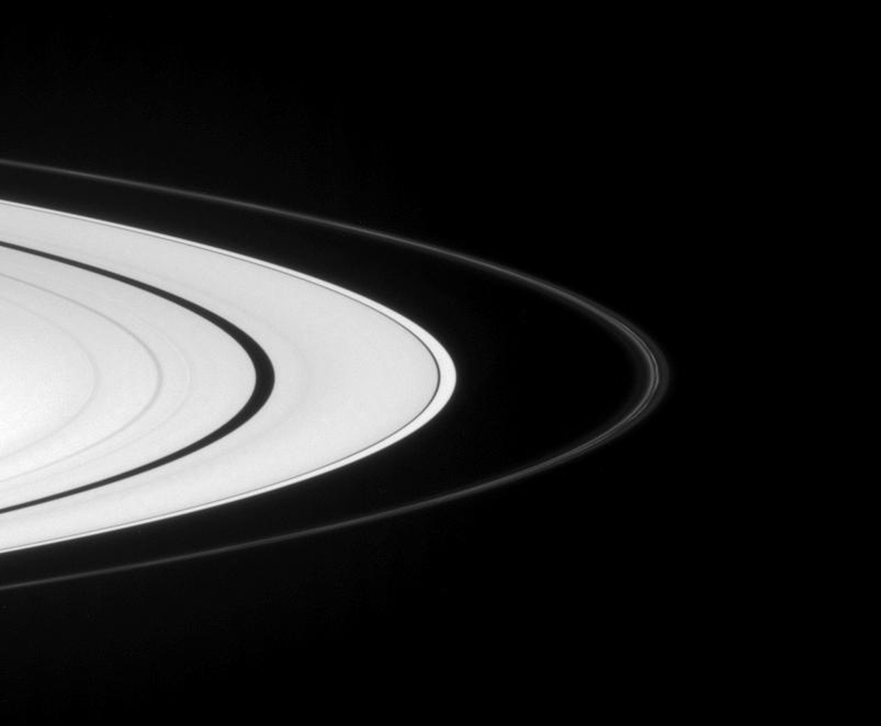 Captured by NASA's Cassini spacecraft on Sept. 7, 2007, Saturn's narrow F ring displays two bright strands, flanked by fainter material. The continuing evolution of this quirky ring is an ongoing subject of study for Cassini scientists.