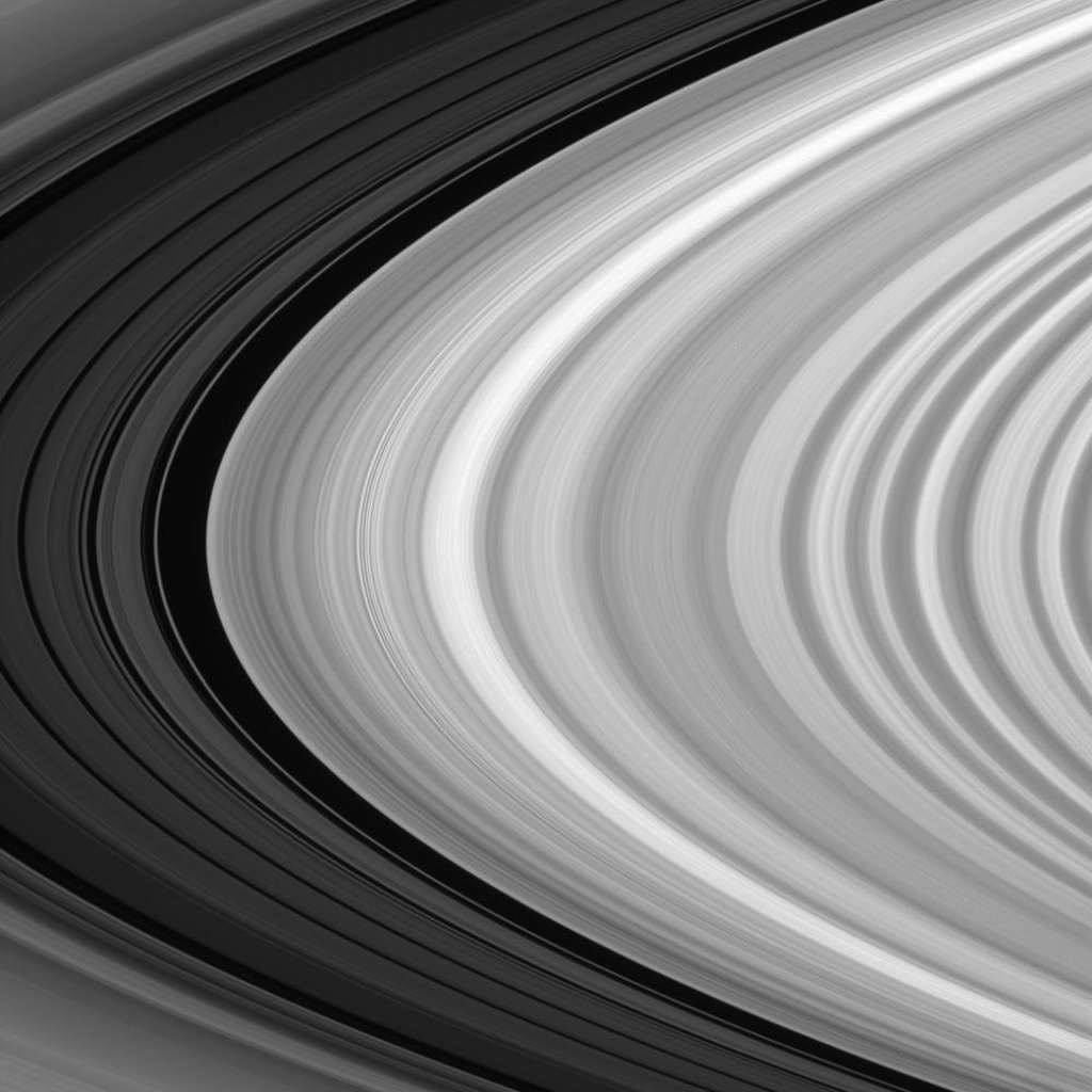 The brilliant B ring ends abruptly at the Huygens Gap, the broad, dark band devoid of ring material at near left. This gap marks the inner edge of the Cassini Division, within which the five dim bands at left reside in this image taken by NASA's Cassini.