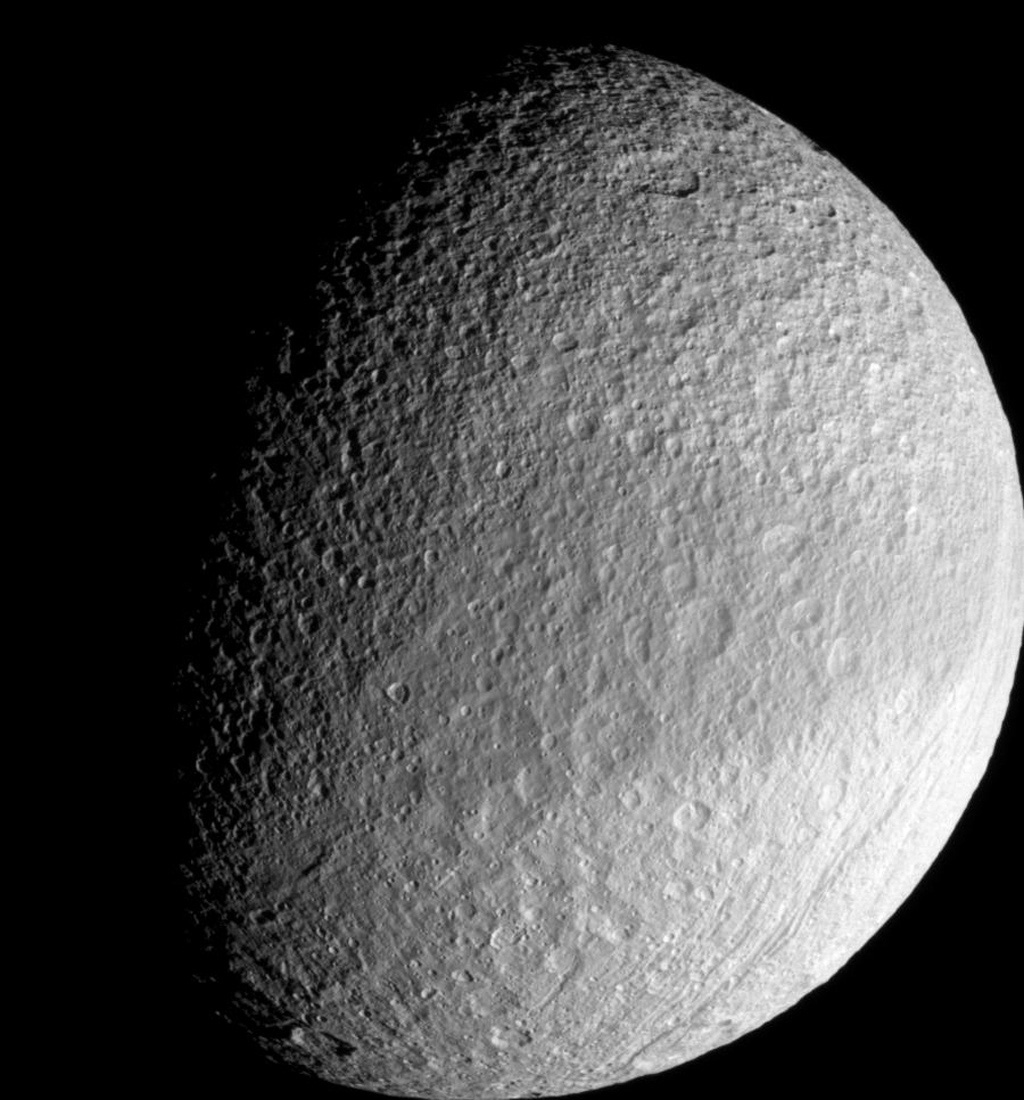 Around the equator on its leading side, Tethys wears a band of slightly darker surface material. This image was taken with NASA's Cassini spacecraft's narrow-angle camera on Sept. 30, 2007.