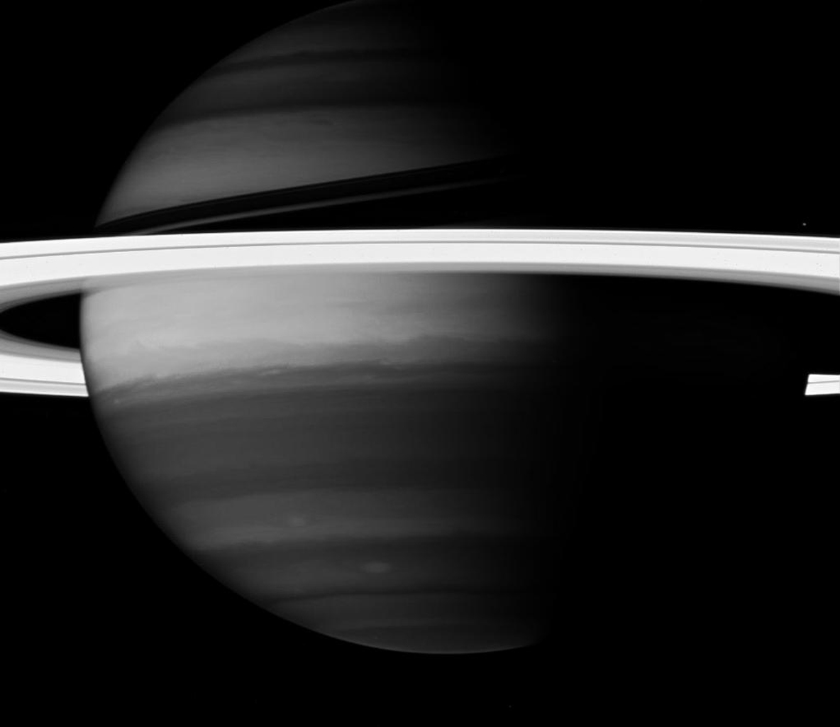 Saturn's rings create a brilliant halo around the turbulent giant planet. Here, NASA's Cassini spacecraft looks into Saturn's clouds using a spectral filter.