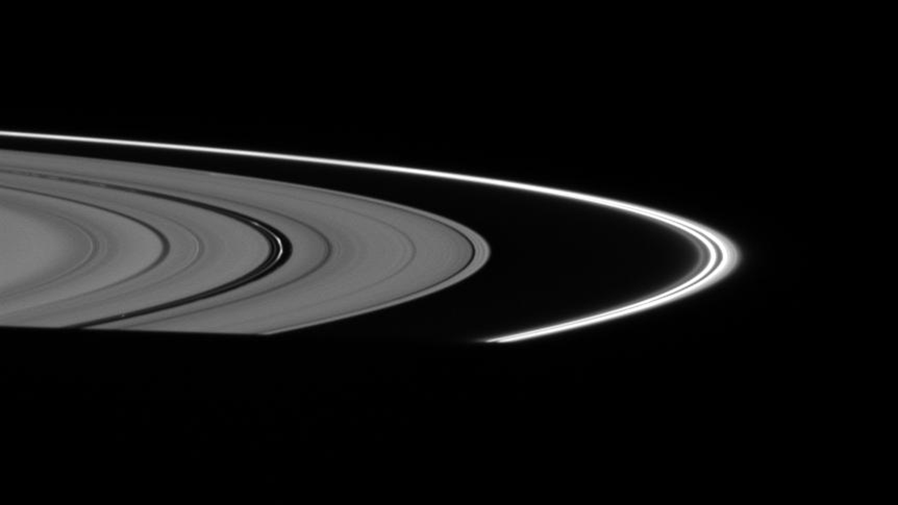 The fine, dust-sized particles of ice in the F ring and Encke Gap ringlets appear relatively bright, with the rings positioned almost directly between NASA's Cassini spacecraft and the Sun taken on Oct. 24, 2007.