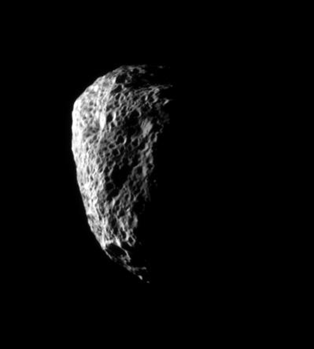 Saturn's irregularly shaped moon Hyperion is completely covered with large pits from which much of its material has been blasted by impacts, never to return. This image was captured by NASA's Cassini spacecraft on Oct. 21, 2007.