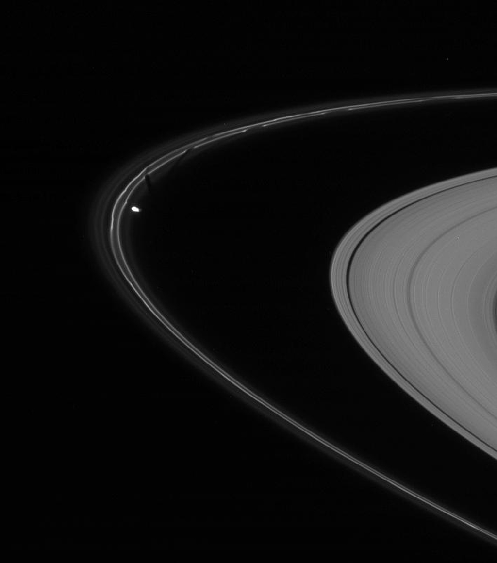 NASA's Cassini spacecraft caught Prometheus in the act of pulling a new streamer out of the F ring's inner edge in this image captured on Nov. 14, 2007.