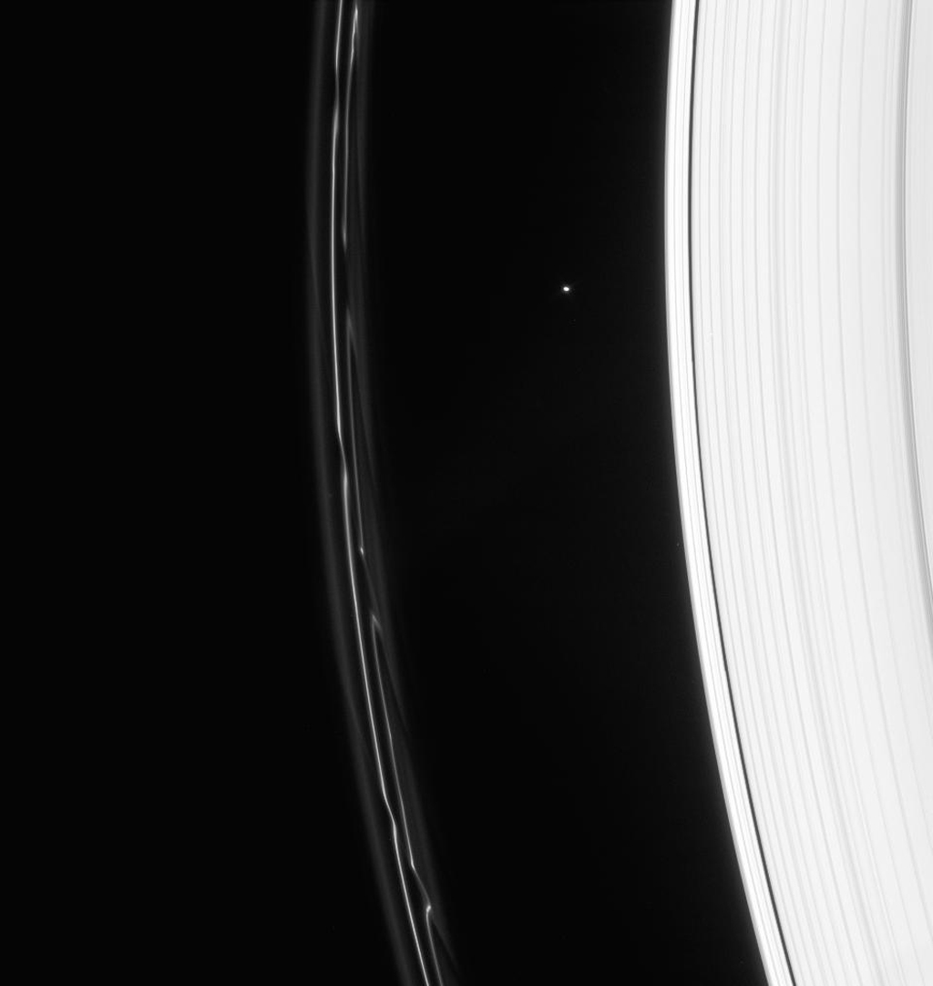 Saturn's F ring displays magnificent structure following the passage of Prometheus. Atlas is seen between the A and F rings, above center in this image captured by NASA's Cassini spacecraft on Jan. 23, 2008.