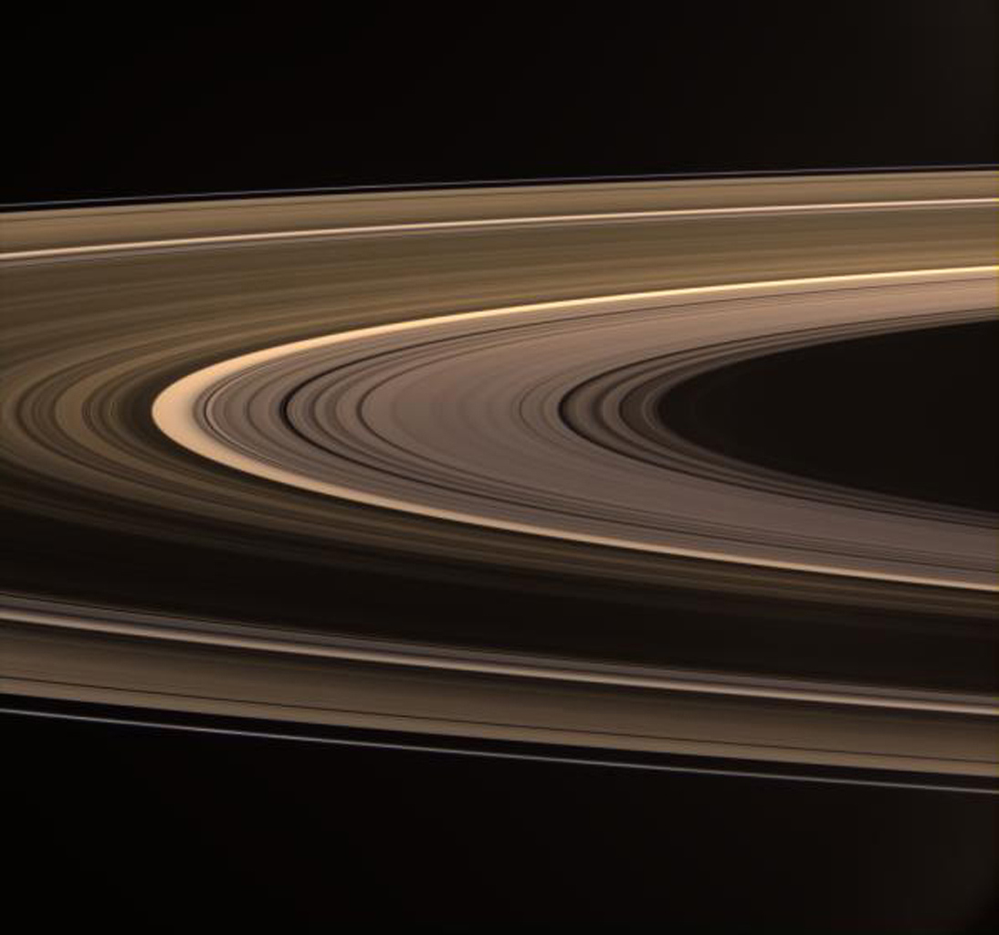 Saturn's softly glowing rings shine in scattered sunlight in this image captured by NASA's Cassini spacecraft. This view looks toward the unilluminated side of the rings from about 5 degrees above the ringplane.
