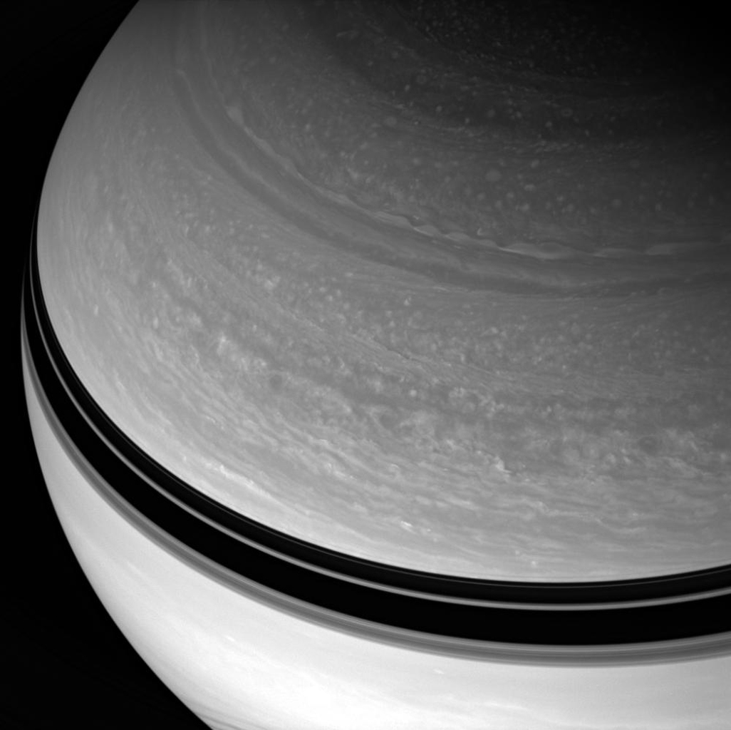 Saturn looms large before NASA's Cassini spacecraft, its blustery cloud bands in restless motion. This view looks toward Saturn's mid-northern latitudes from about 37 degrees above the ringplane. Ring-cast shadows create dark bands across the planet.