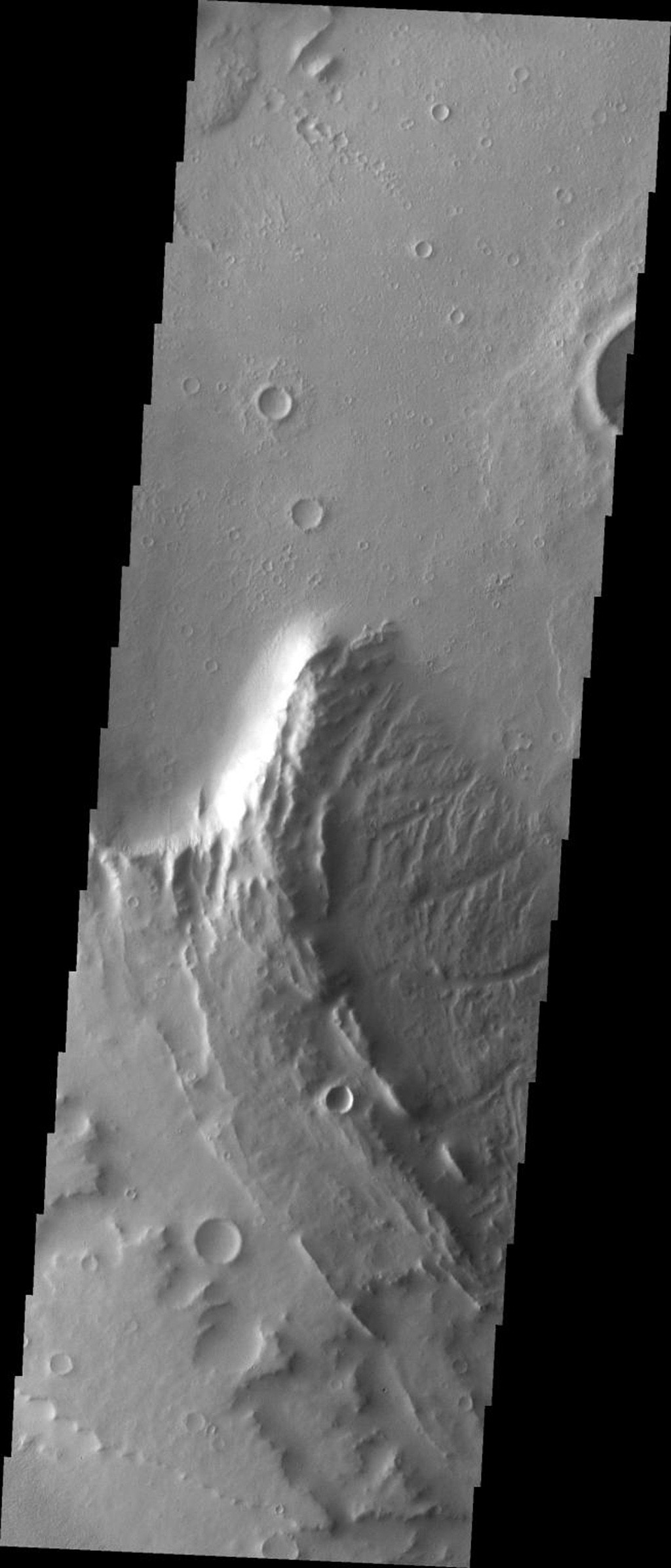 This image from NASA's Mars Odyssey spacecraft shows part of the summit caldera of Apollinaris Patera, an old volcano on Mars that has undergone extensive erosion.