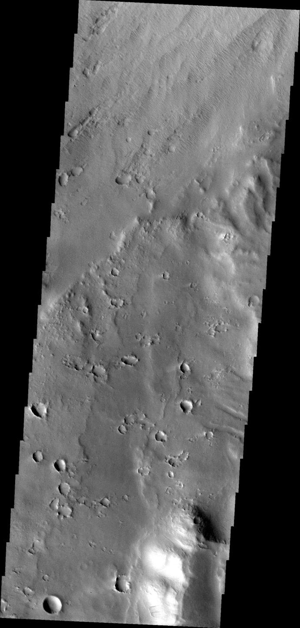 This image from NASA's Mars Odyssey spacecraft shows Apollinaris Patera, an old volcano on Mars that has undergone extensive erosion.