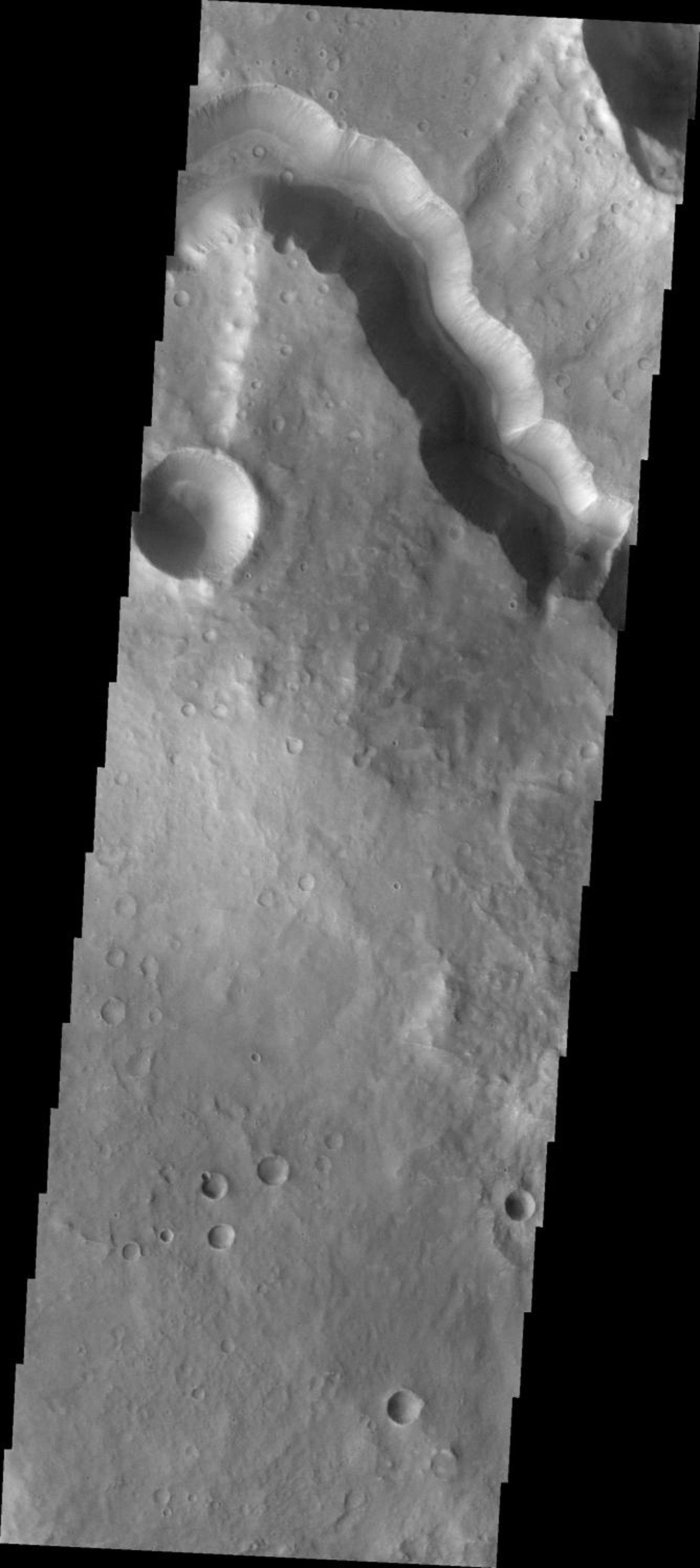 This image from NASA's Mars Odyssey spacecraft shows Tinto Vallis bounded by steep walls on Mars.