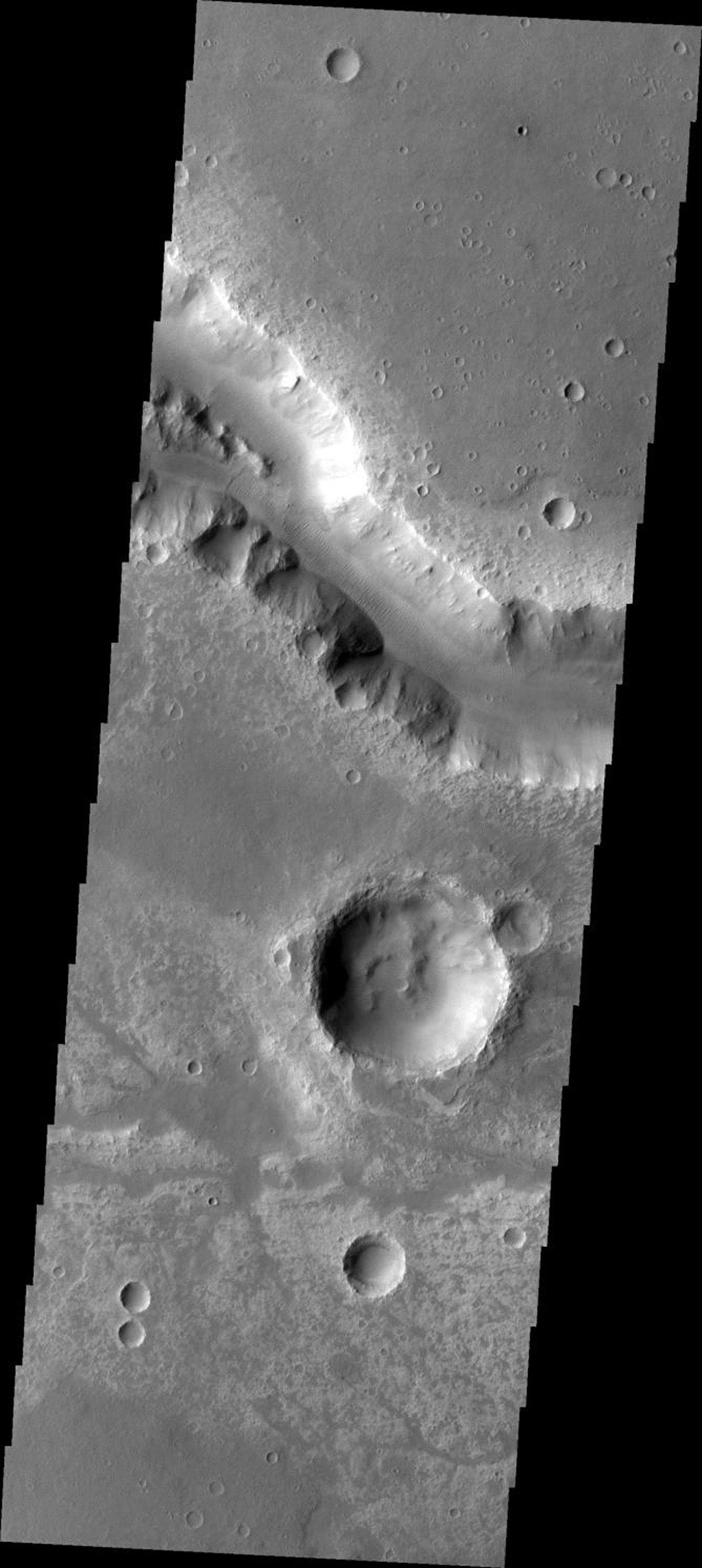 This image from NASA's Mars Odyssey spacecraft shows Her Desher Vallis, a medium-sized channel on Mars.