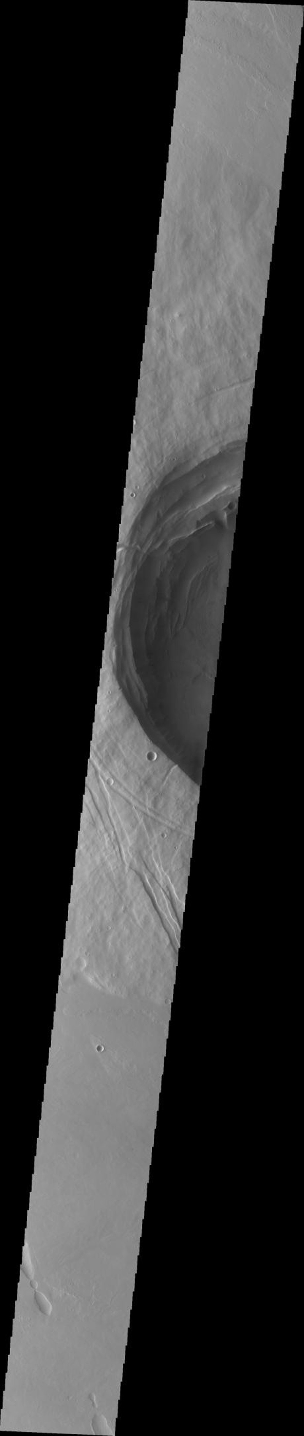 This image from NASA's Mars Odyssey spacecraft shows Biblis Patera on Mars. Note the large size and depth of the summit caldera in relation to the size of the entire construct.