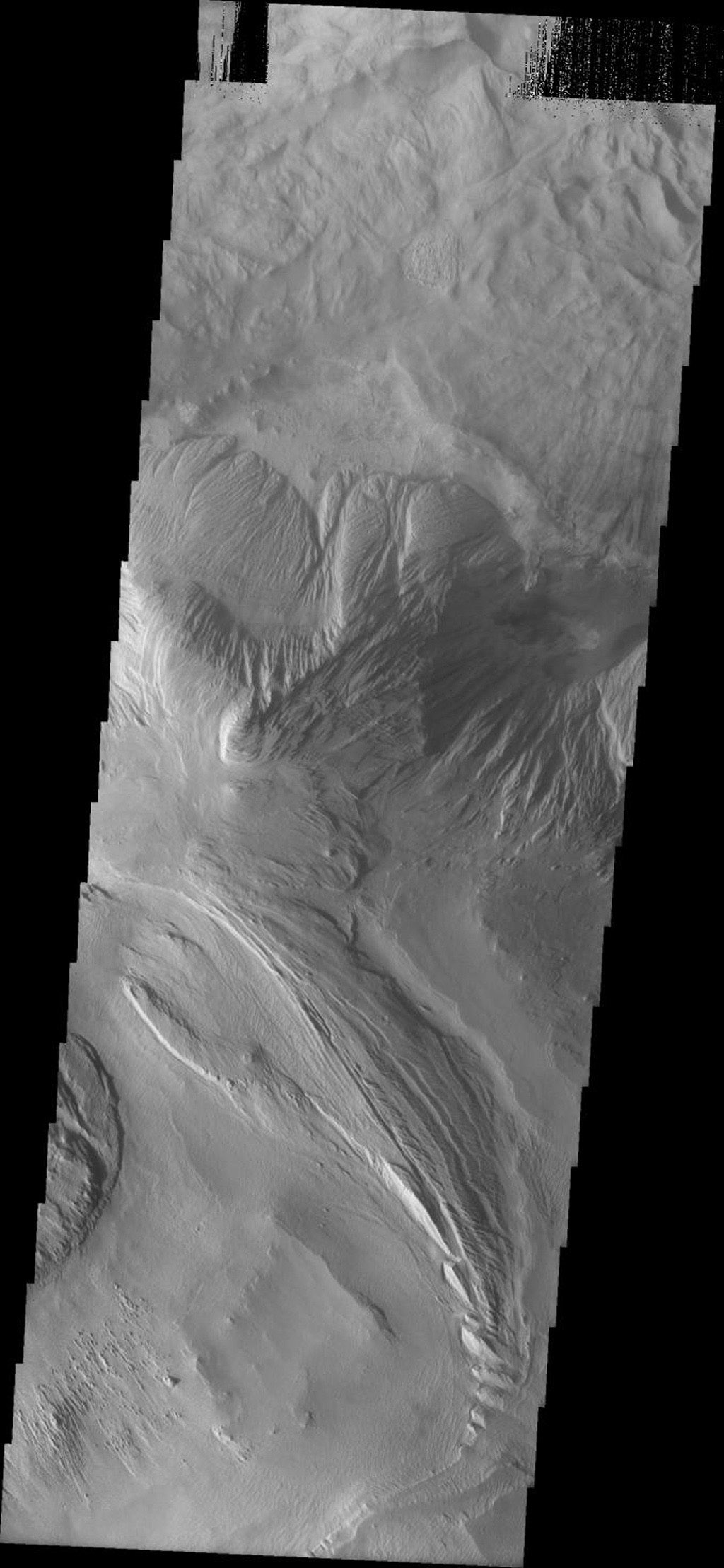 This image from NASA's Mars Odyssey spacecraft shows a portion of the floor of Ophir Chasma on Mars. At top is a landslide deposit. In the center is a wind and perhaps water eroded highland. At bottom wind appears to be the main agent of erosion.