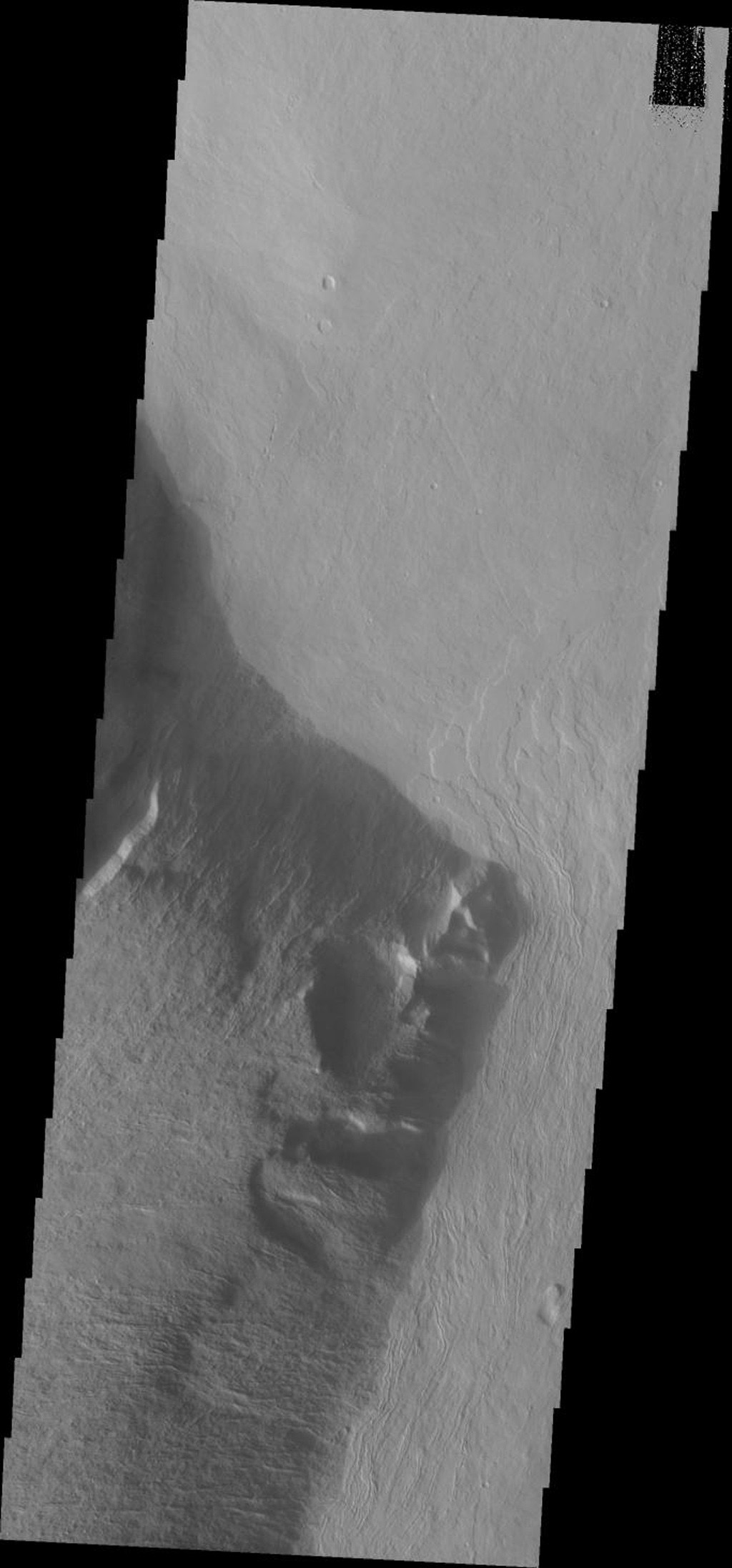 This image from NASA's Mars Odyssey spacecraft shows part of the escarpment of the Olympus Mons volcano on Mars.