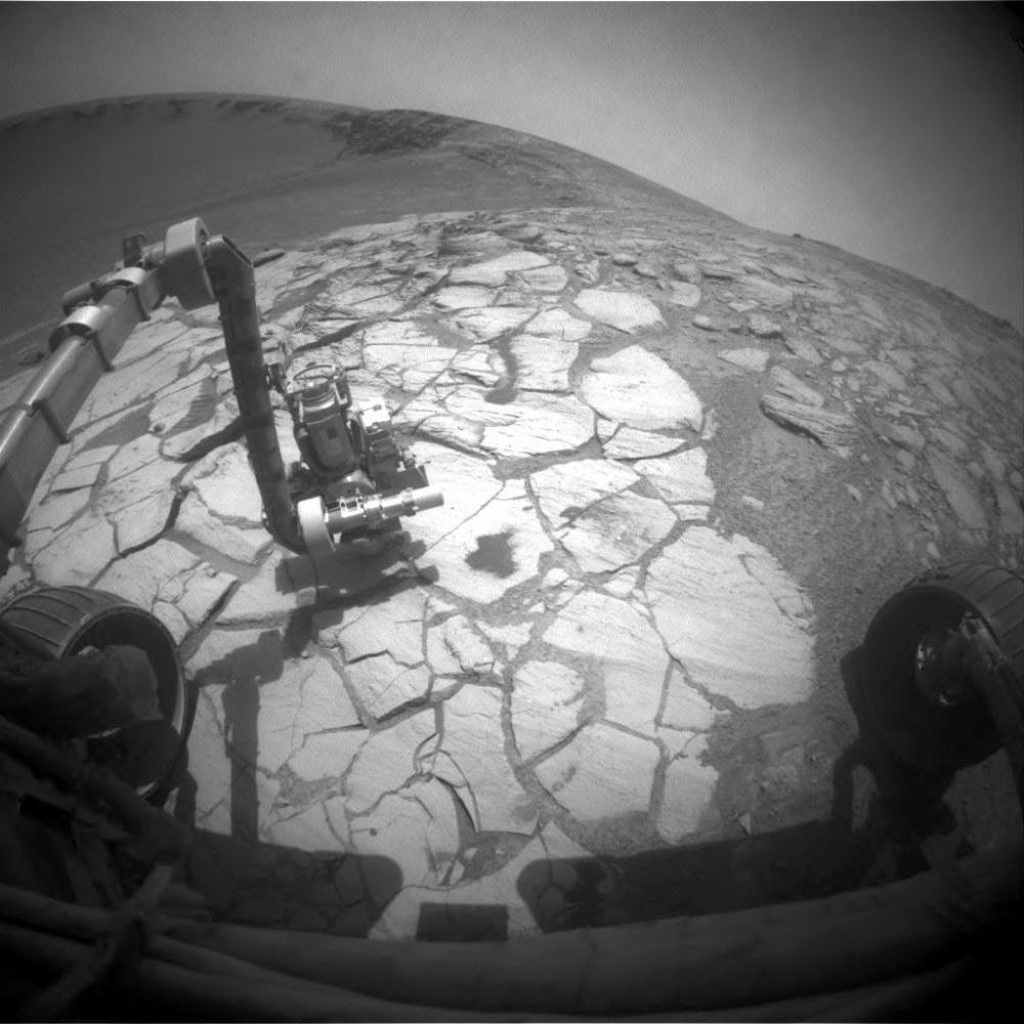 NASA's Mars Exploration Rover Opportunity used its front hazard-identification camera to capture this wide-angle view of its robotic arm extended to a rock in a bright-toned layer inside Victoria Crater on Oct. 13, 2007.
