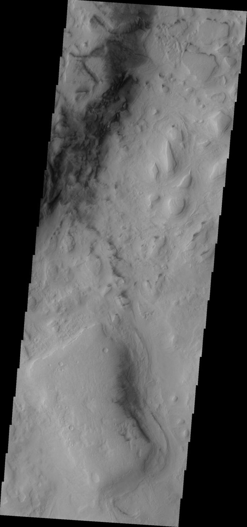 This image from NASA's Mars Odyssey shows small, dark dunes located on the floor of Hellas Basin on Mars.