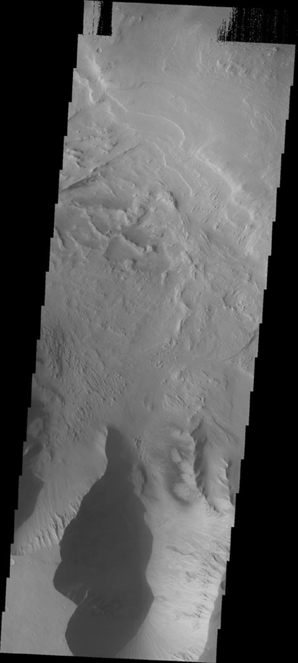 This image from NASA's Mars Odyssey shows a portion of Candor Chasma on Mars, including unusual dark markings on part of the canyon wall.