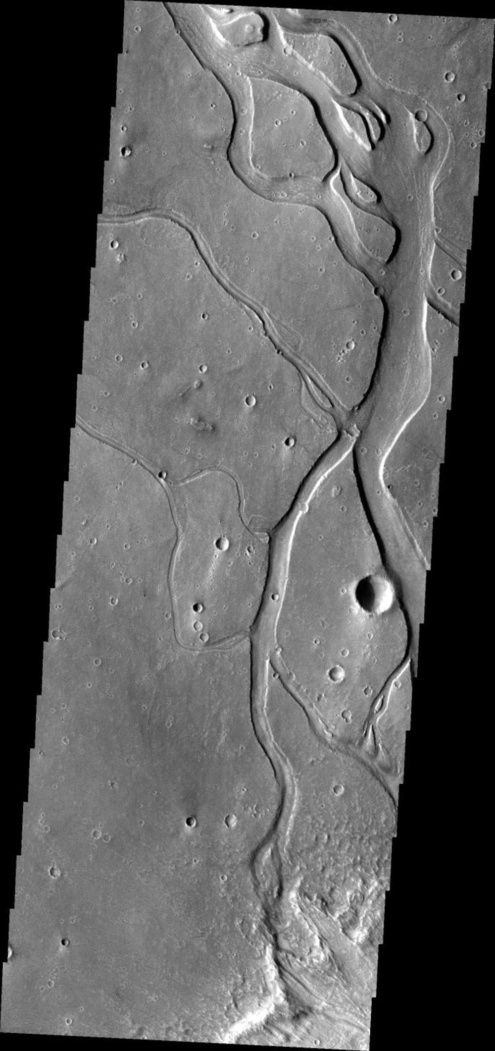 This image from NASA's Mars Odyssey shows channels and streamlined islands, part of Hebrus Valles on Mars.