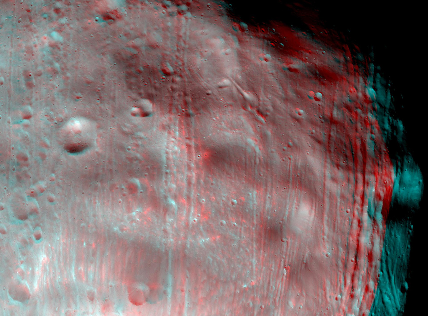 NASA's Mars Reconnaissance Orbiter took two images of the larger of Mars' two moons, Phobos, within 10 minutes of each other on March 23, 2008. 3D glasses are necessary to view this image.