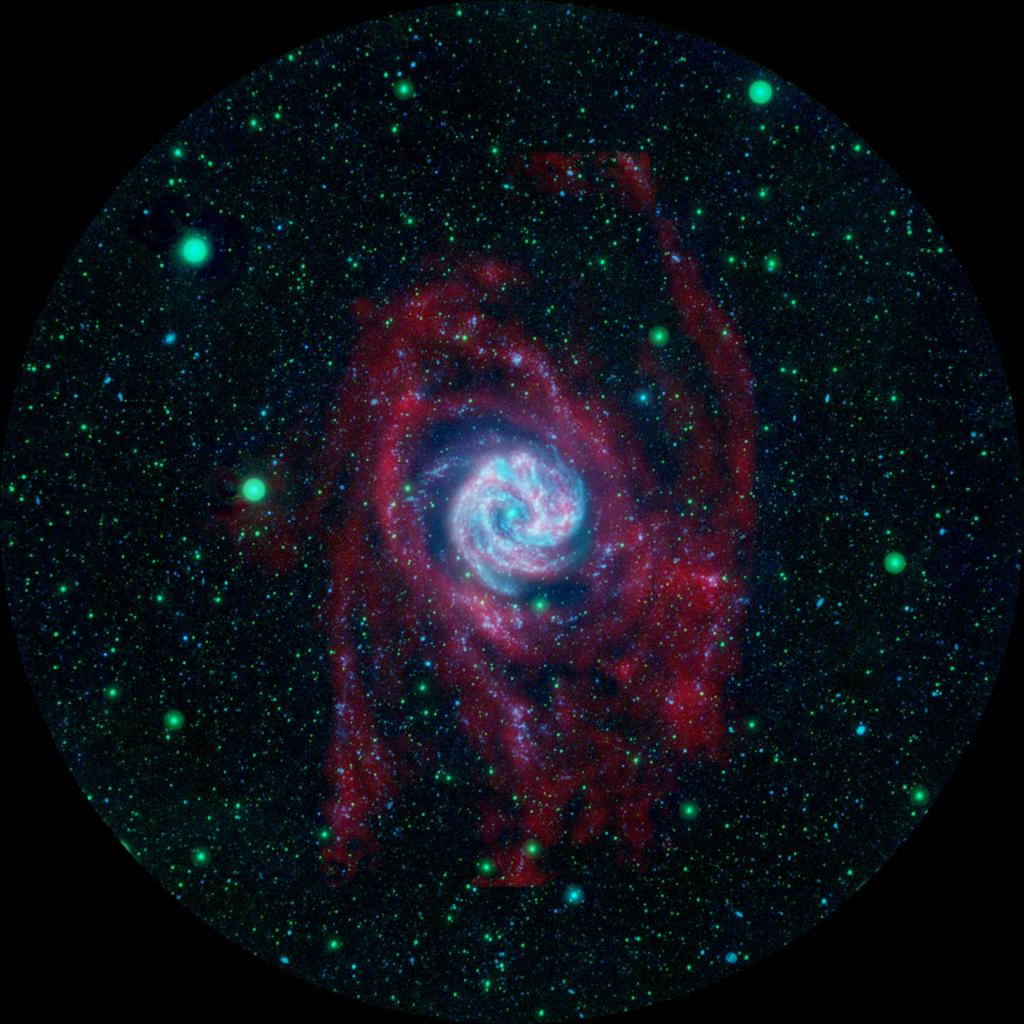 The outlying regions around the Southern Pinwheel galaxy, or M83, are highlighted in this composite image from NASA's Galaxy Evolution Explorer and the National Science Foundation's Very Large Array in New Mexico.