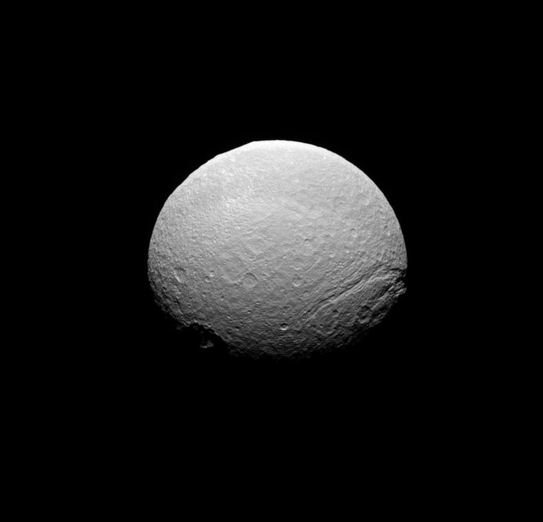 NASA's Cassini spacecraft takes in a southern view of the scarred face of Saturn's icy moon Tethys.