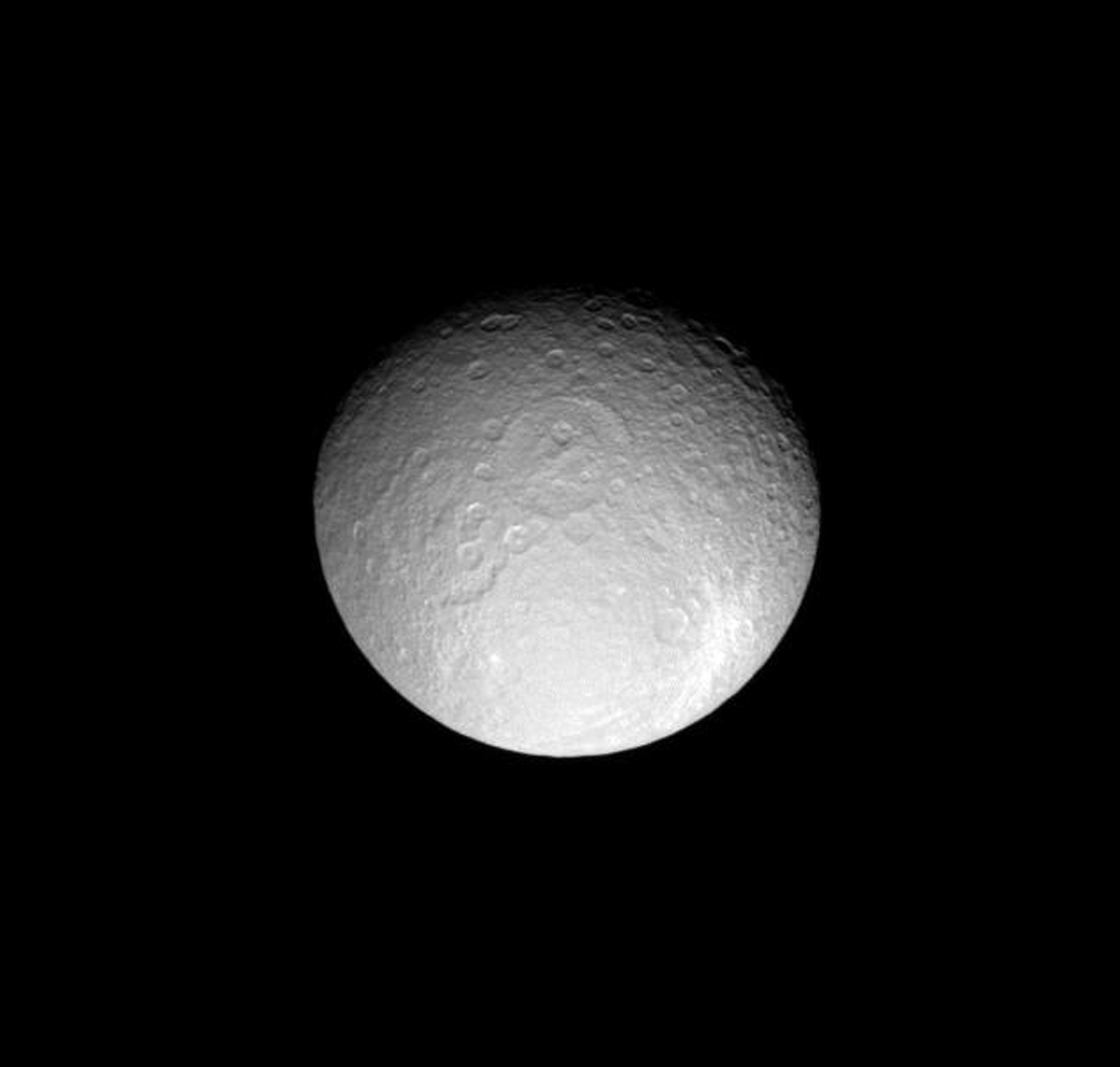 This view of Saturn's moon Rhea includes two large and ancient impact basins and a more recent, bright ray crater. This image was taken in visible light with NASA's Cassini spacecraft's narrow-angle camera on May 13, 2008.