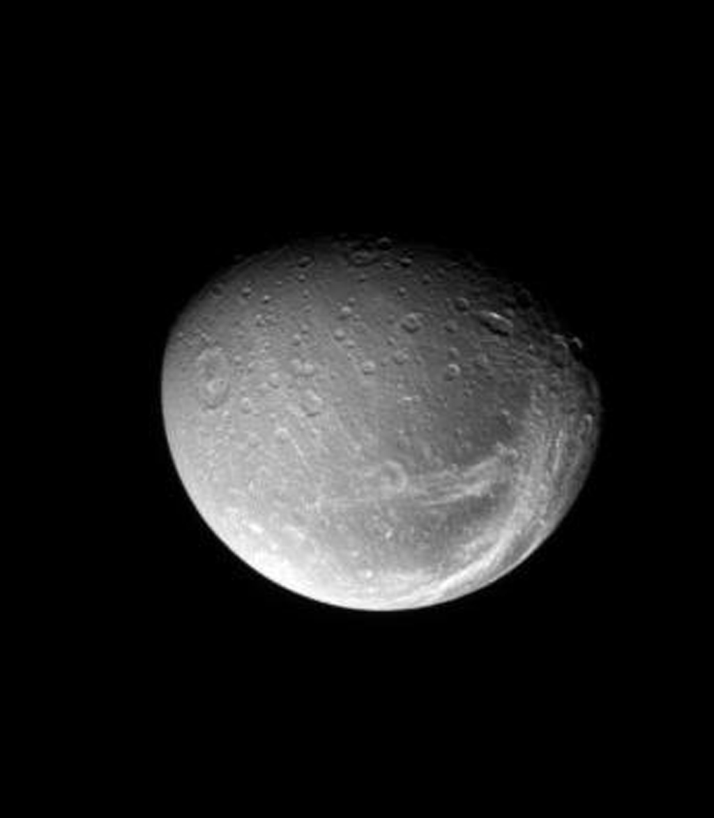 The bright fractures on Dione's trailing side slice across terrain that is darker than the rest of the surface. This image was taken in visible light with NASA's Cassini spacecraft's narrow-angle camera on May 17, 2008.